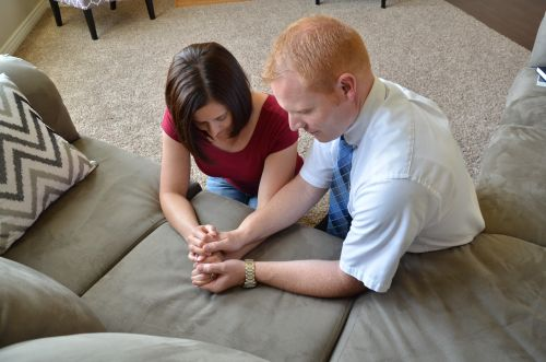 Husband and Wife kneeling in Prayer,