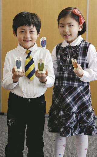 girl and boy holding up images