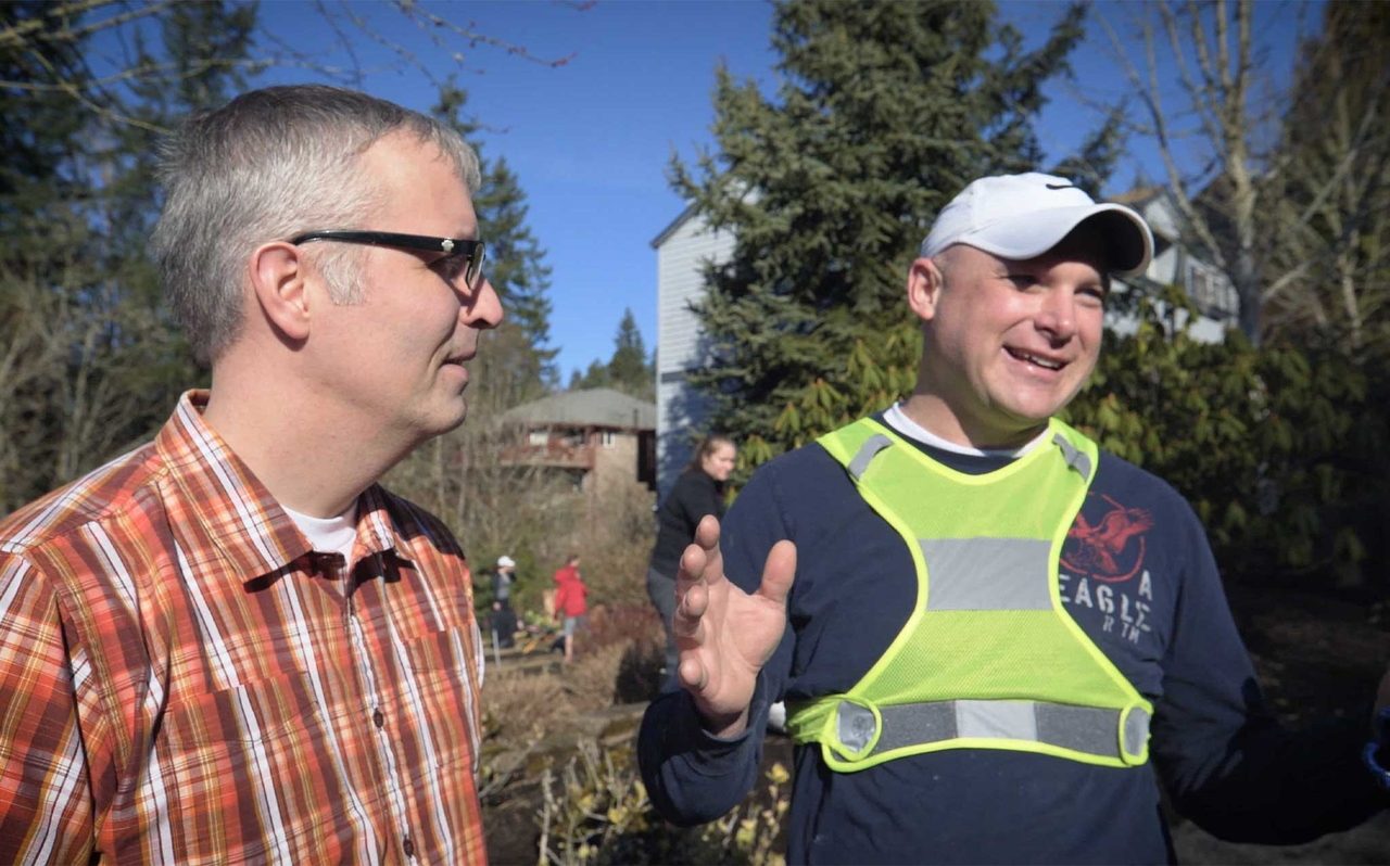 Two men preform service for their neighbor