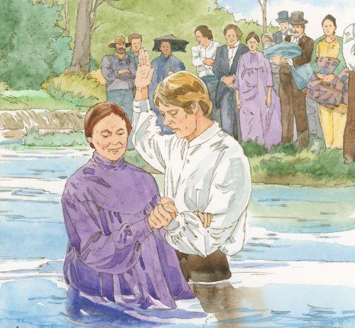 man baptizing woman