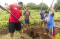 Fanguna family planting crops