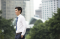 Kuala Lumpur, Selangor, Malaysia: Asian businessman walking outdoors
