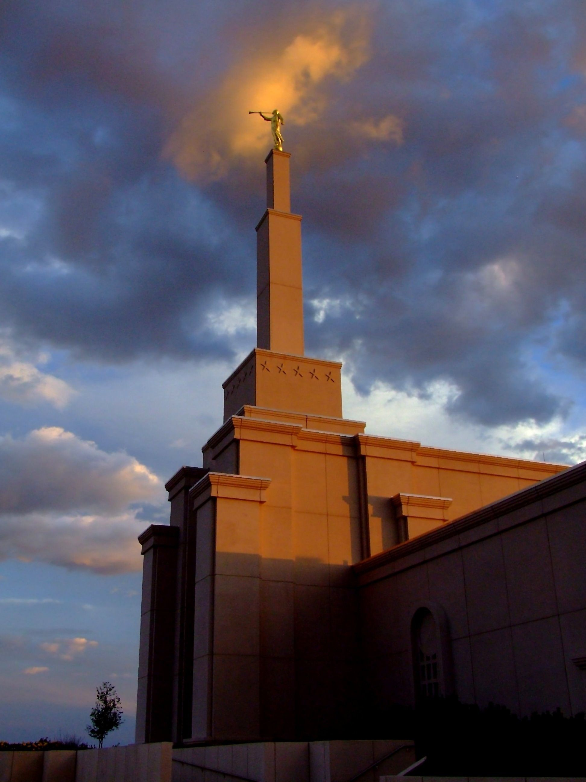 The tall spire on the Albuquerque New Mexico Temple in the evening.