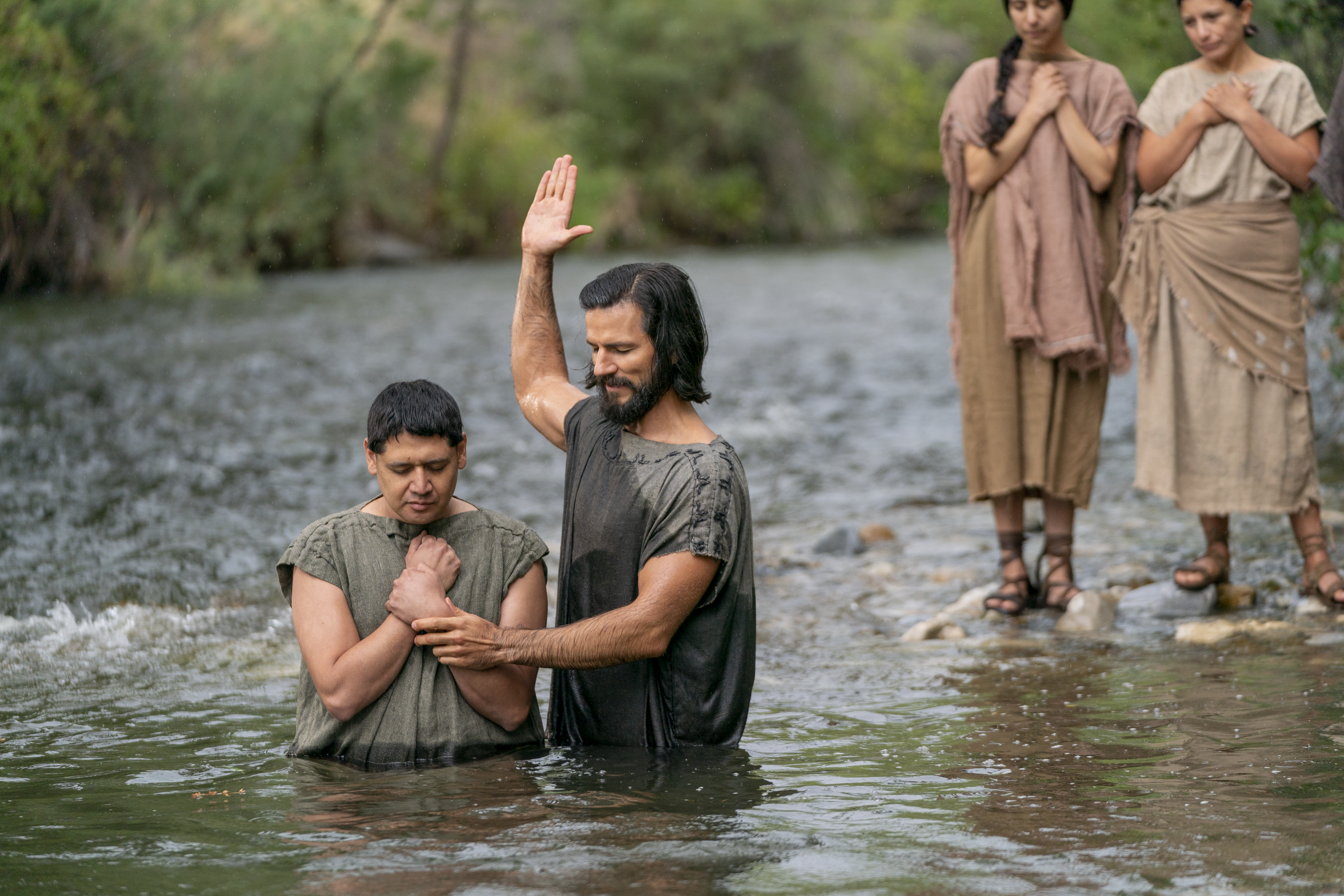 Alma the Younger baptizes believers in the land of Zarahemla.