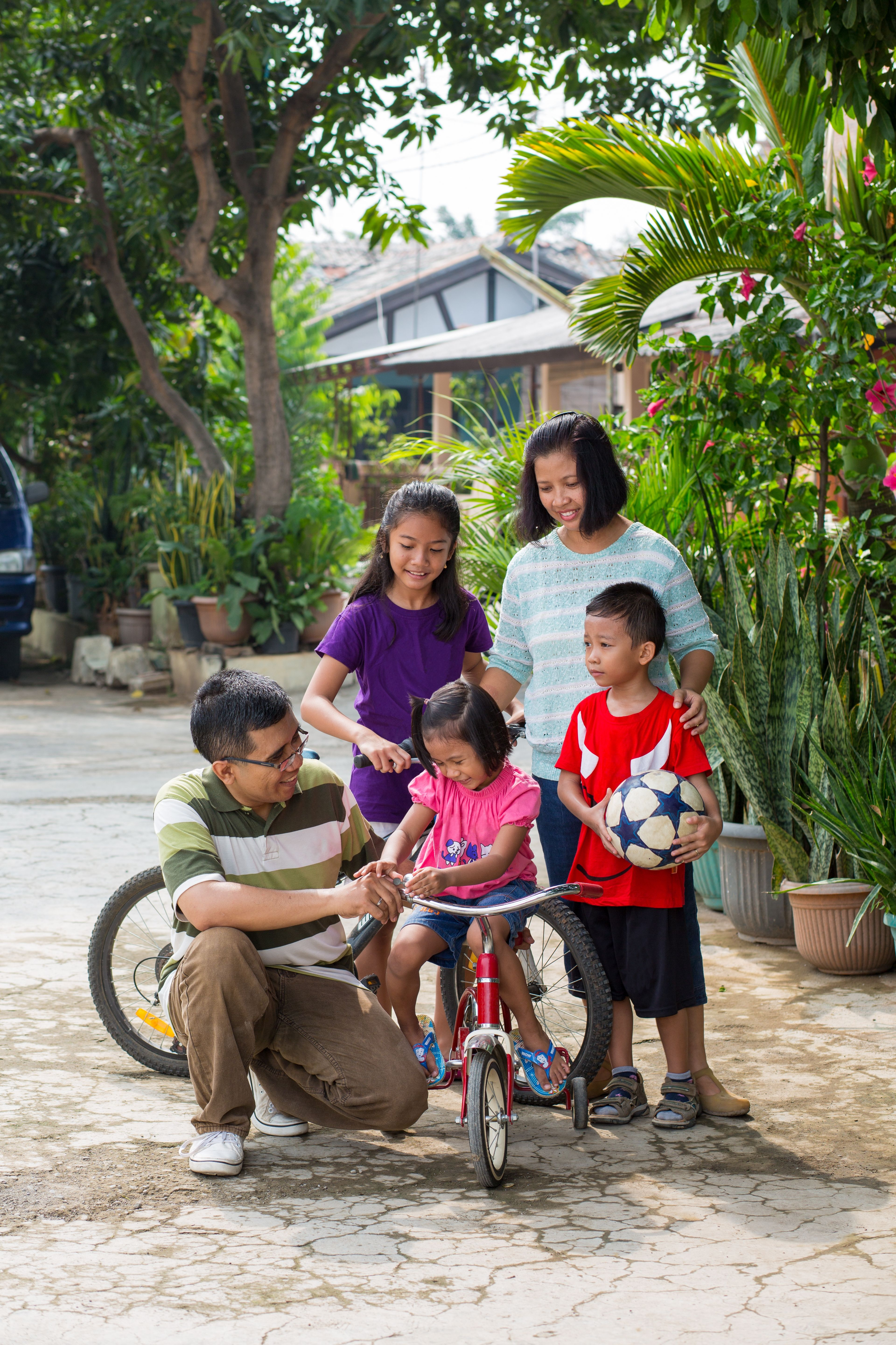 A family preparing to ride bikes together.