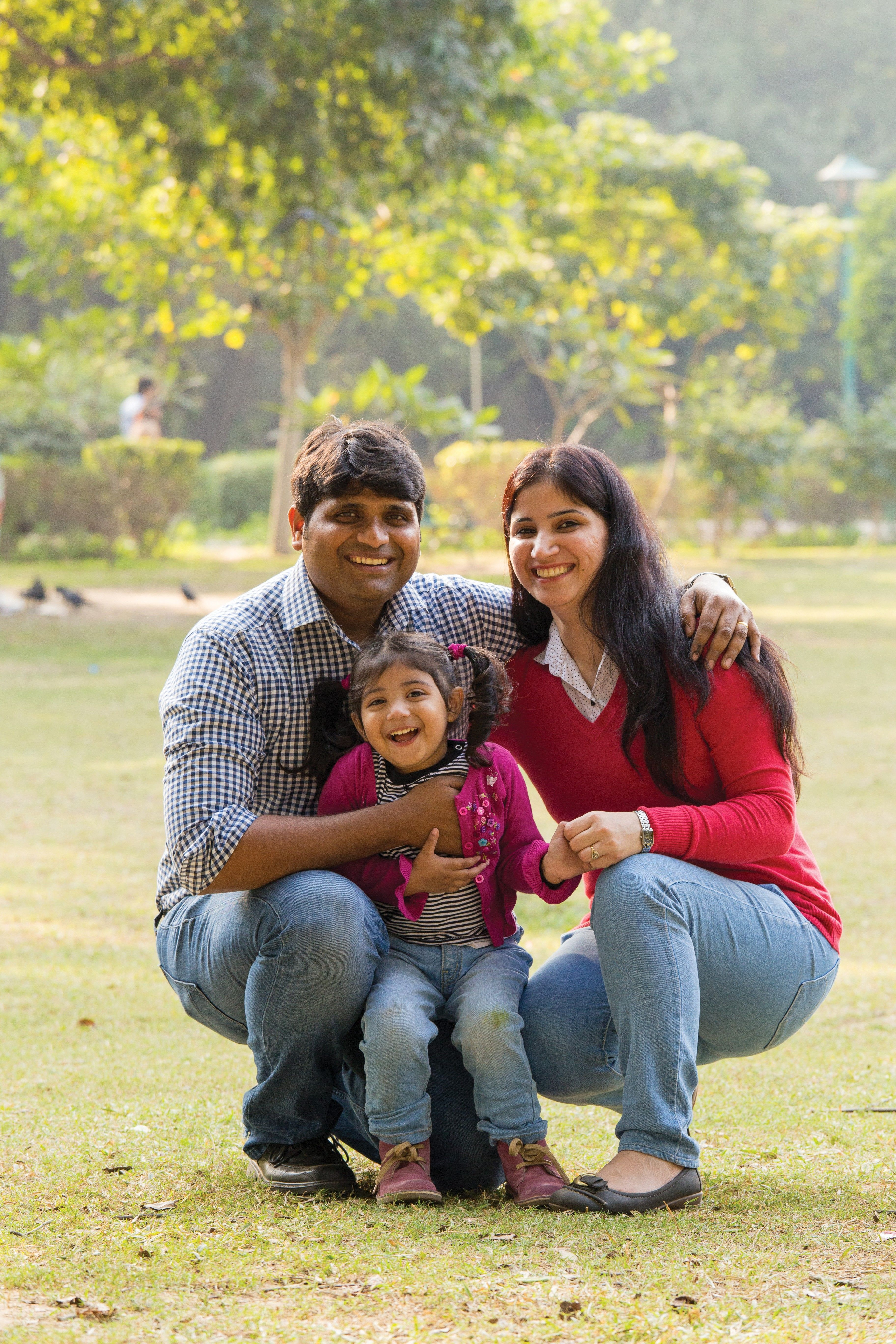 A young family from India at the park together.