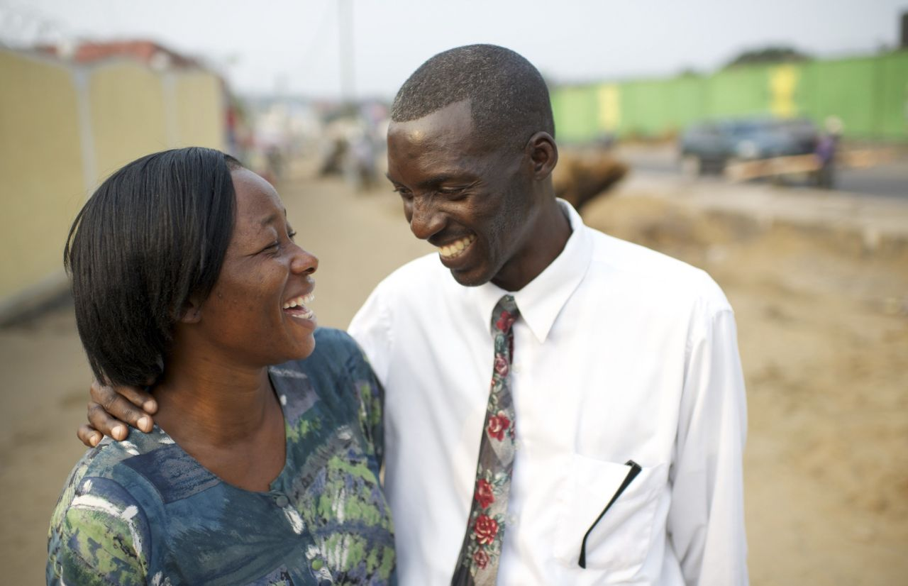 A couple smile together as they contemplate the blessings of marriage