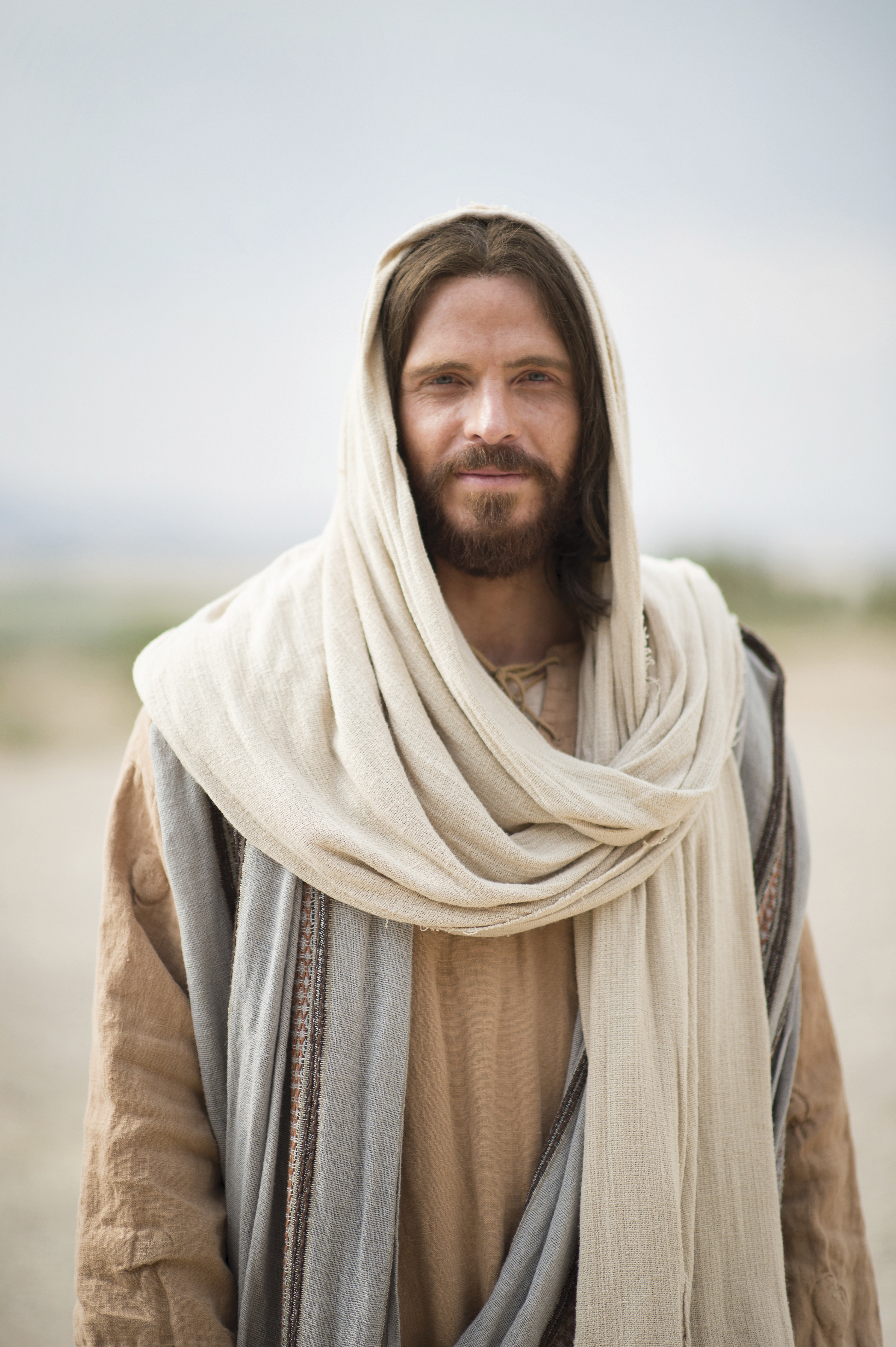 Portrait of Jesus Christ standing alone and smiling.