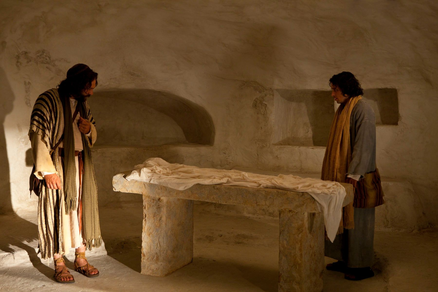 Peter and John enter Christ's tomb to find that He is gone.