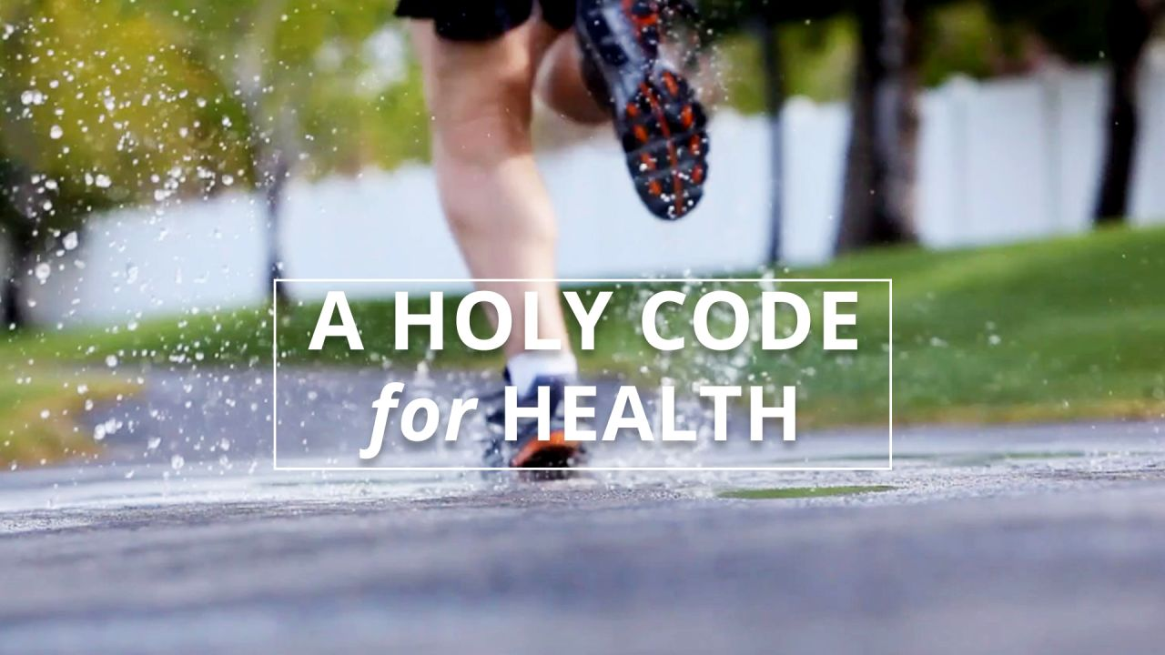 A man runs down a street following the precepts of the word of wisdom by trying to stay healthy