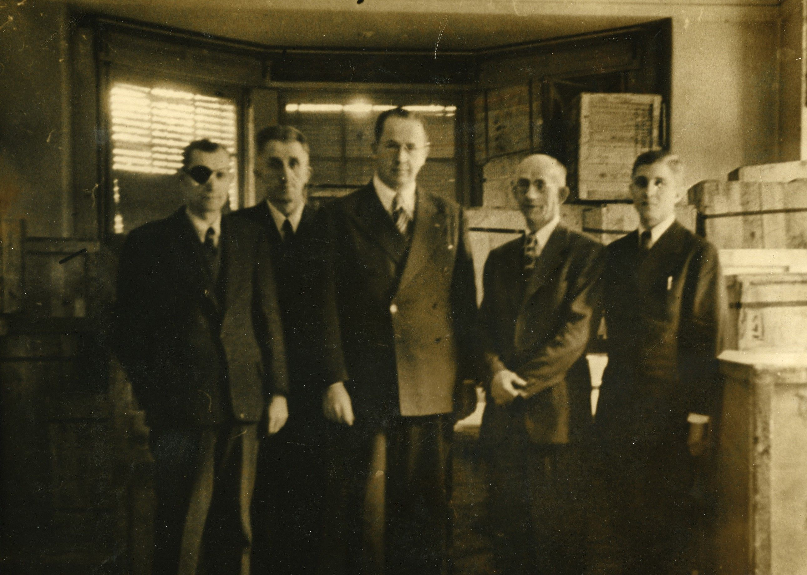 President Ezra Taft Benson standing with other men during a visit to the European Mission in 1946.