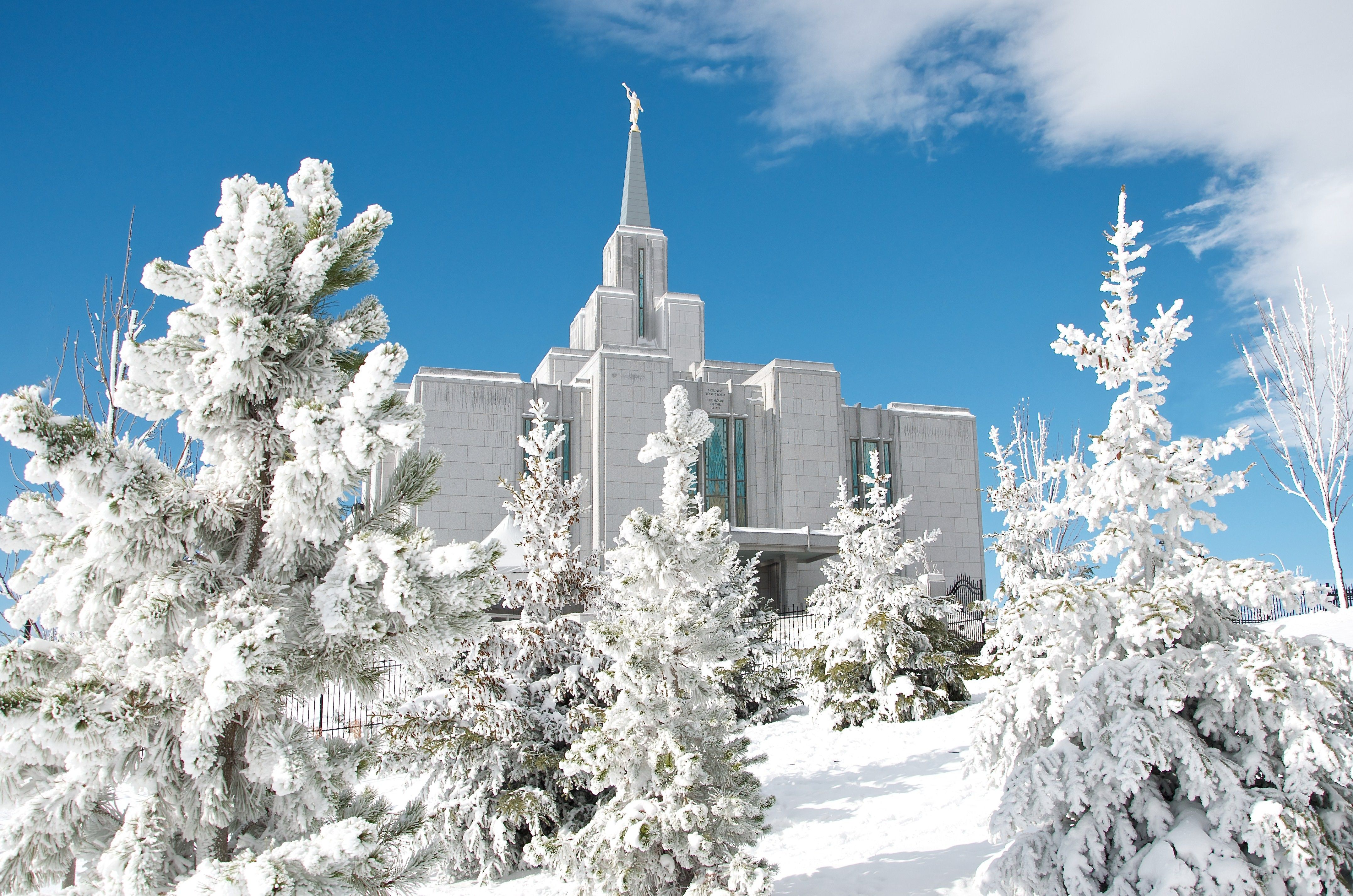 The Calgary Alberta Temple is covered in snow during the winter.