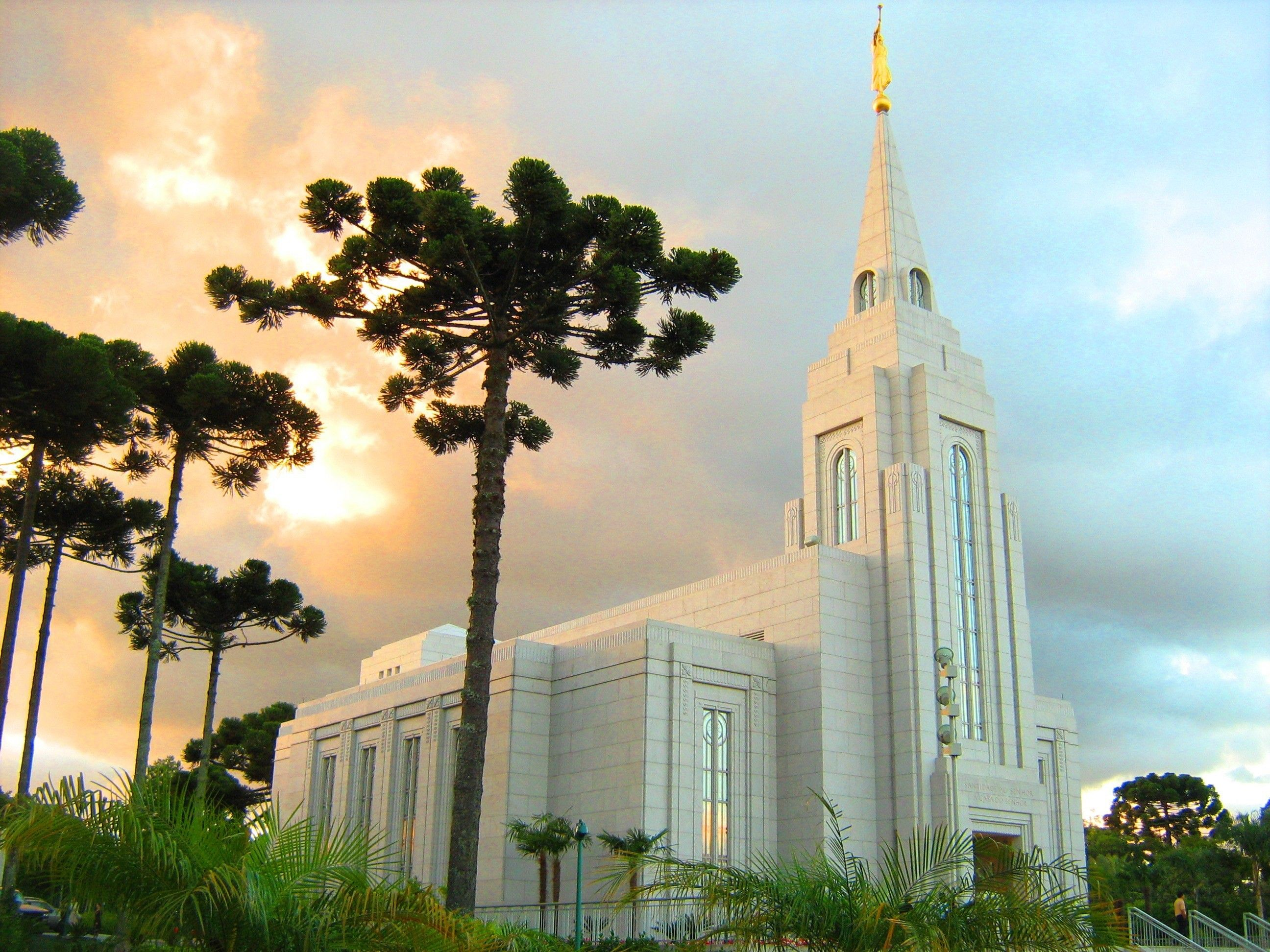 The Curitiba Brazil Temple at sunset, including entrance and scenery.