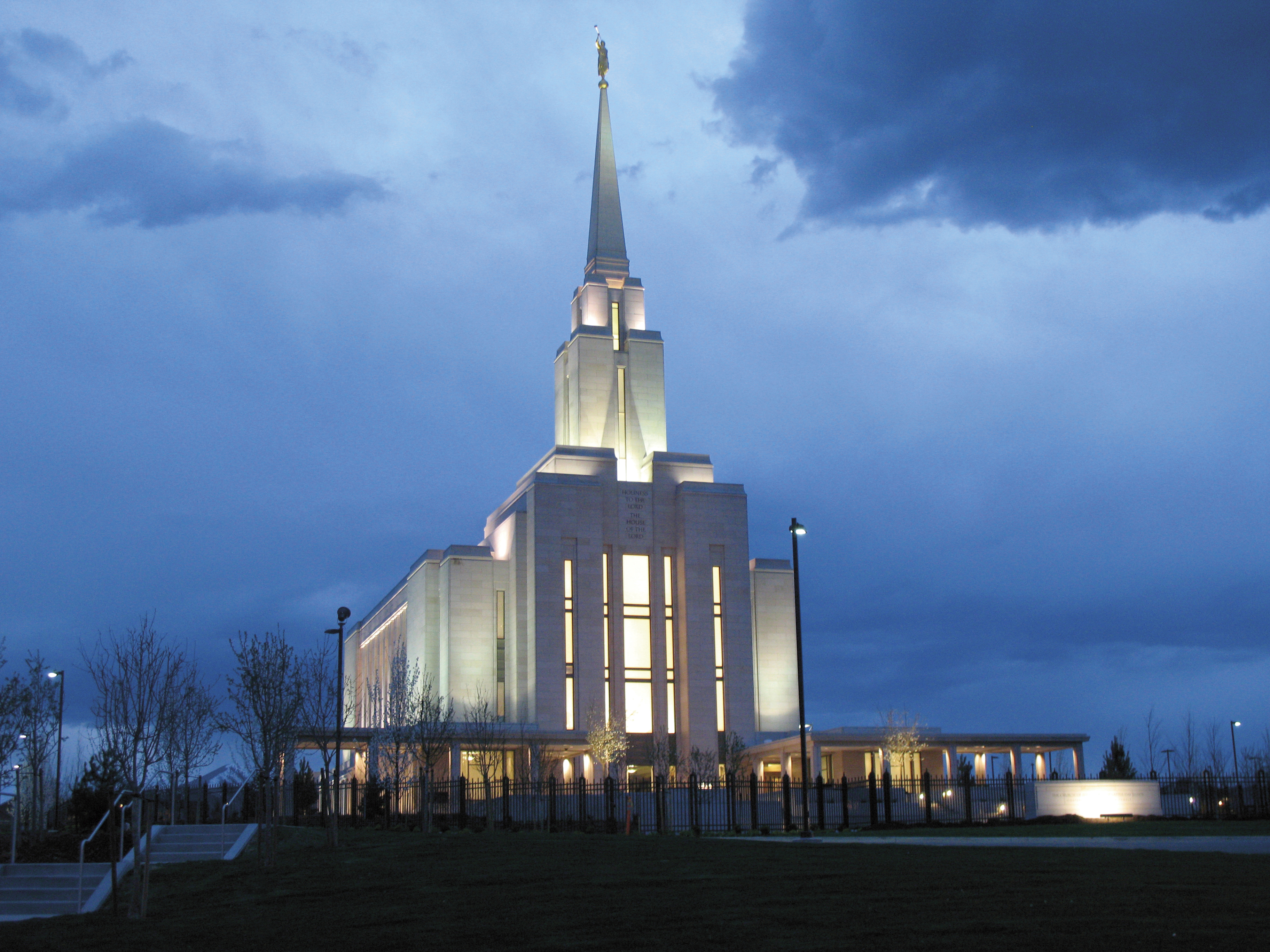 The Oquirrh Mountain Utah Temple in the evening, including the entrance and scenery.