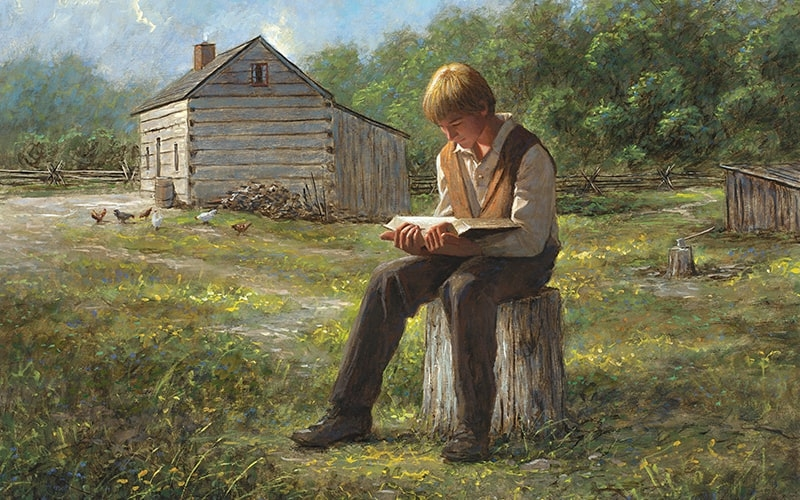 Joseph Smith as a young man in his barnyard reads from the Bible leading to the restoration of Jesus Christ's church