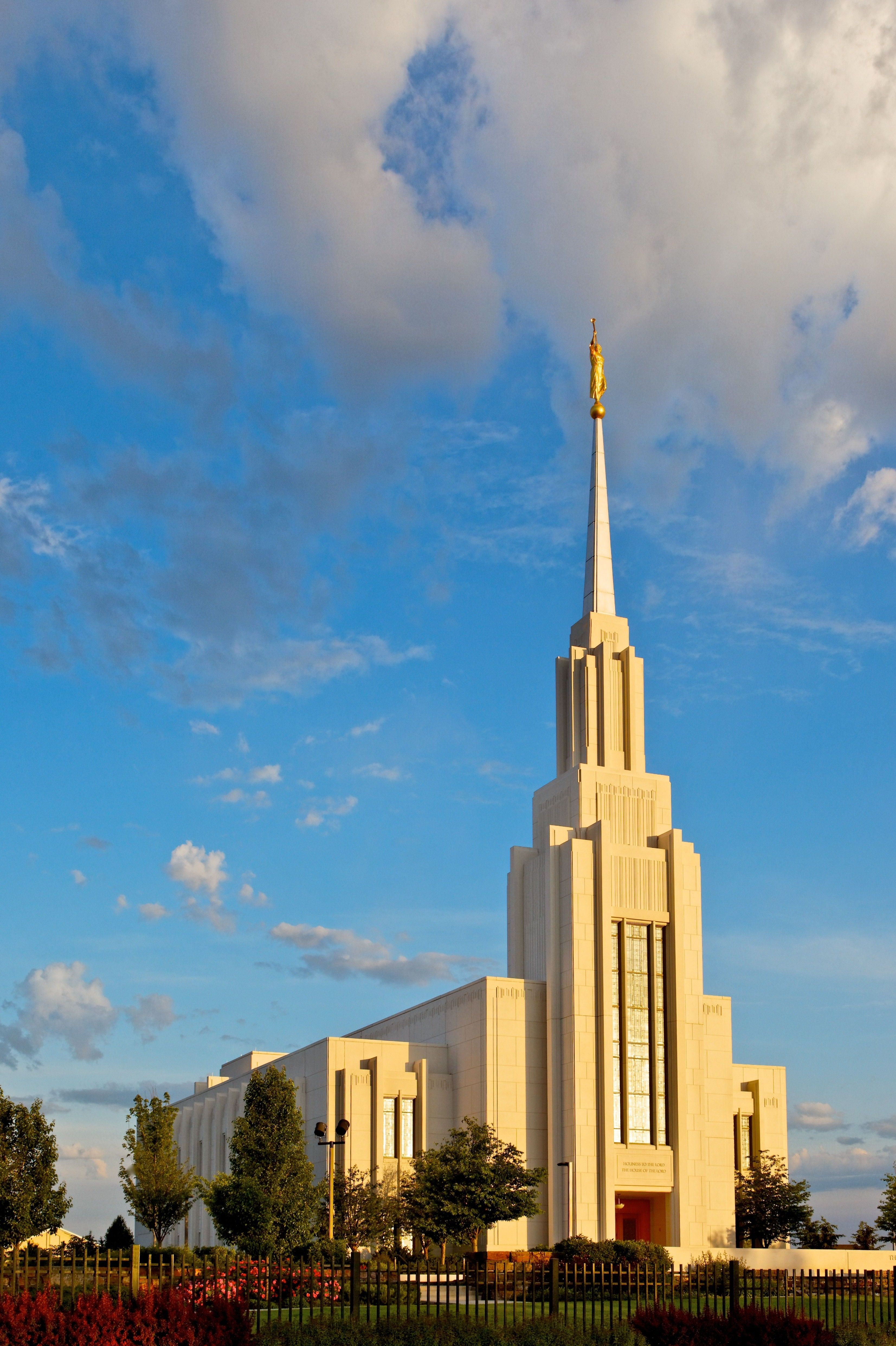The Twin Falls Idaho Temple during daylight, including the entrance and scenery.
