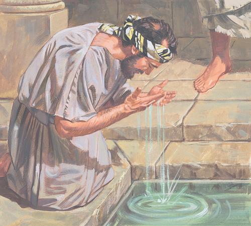 blind man washing his eyes