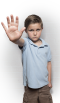 boy with right hand raised in front of him