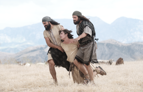 Laman and Lemuel drag Nephi who is tied up