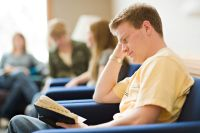 Young Adult Reading the Scriptures