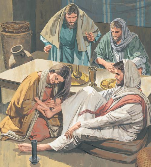 woman washing Jesus's feet