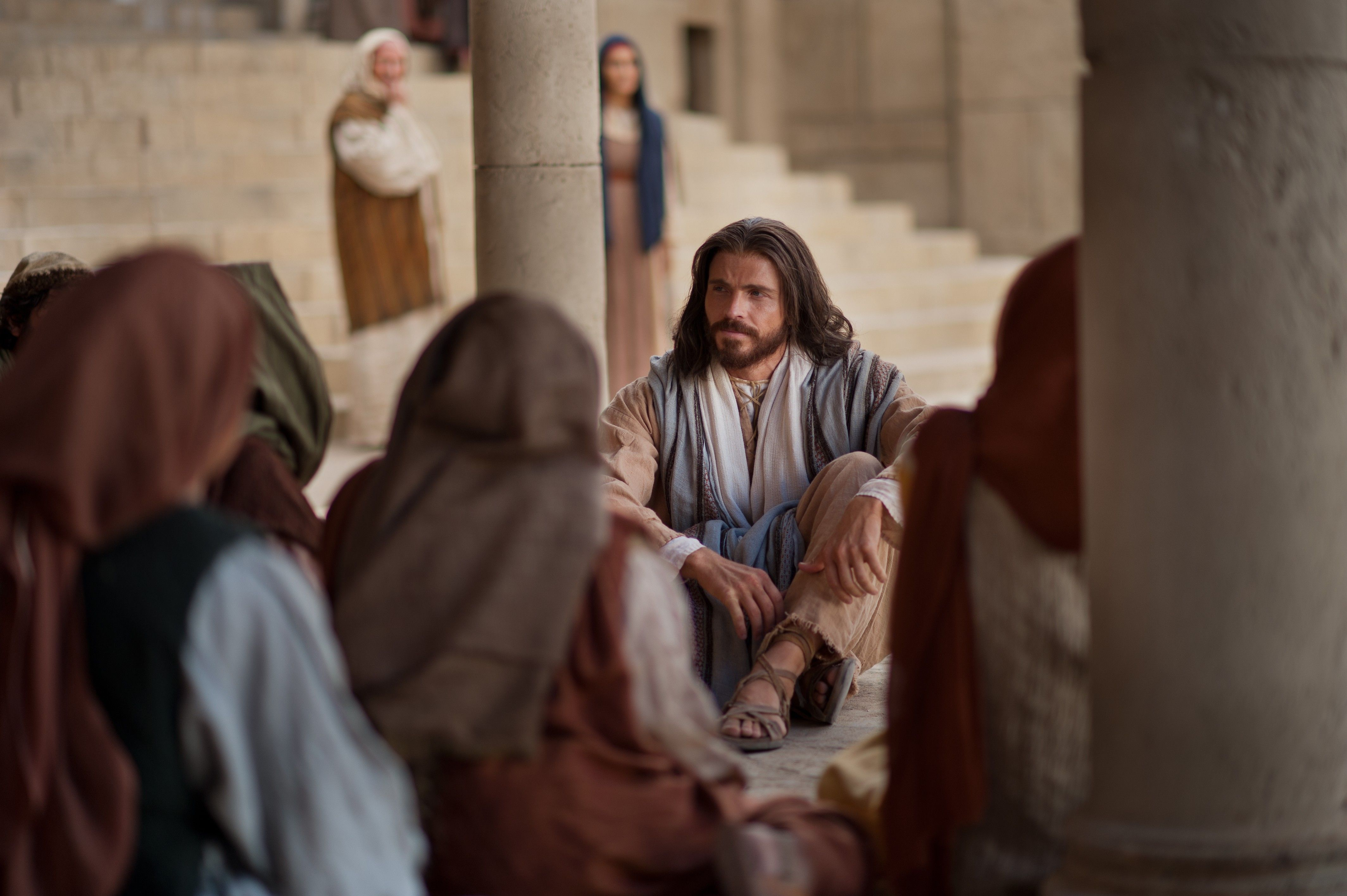 """Christ teaching a group of people to turn the other cheek instead of living by """"an eye for an eye."""""""