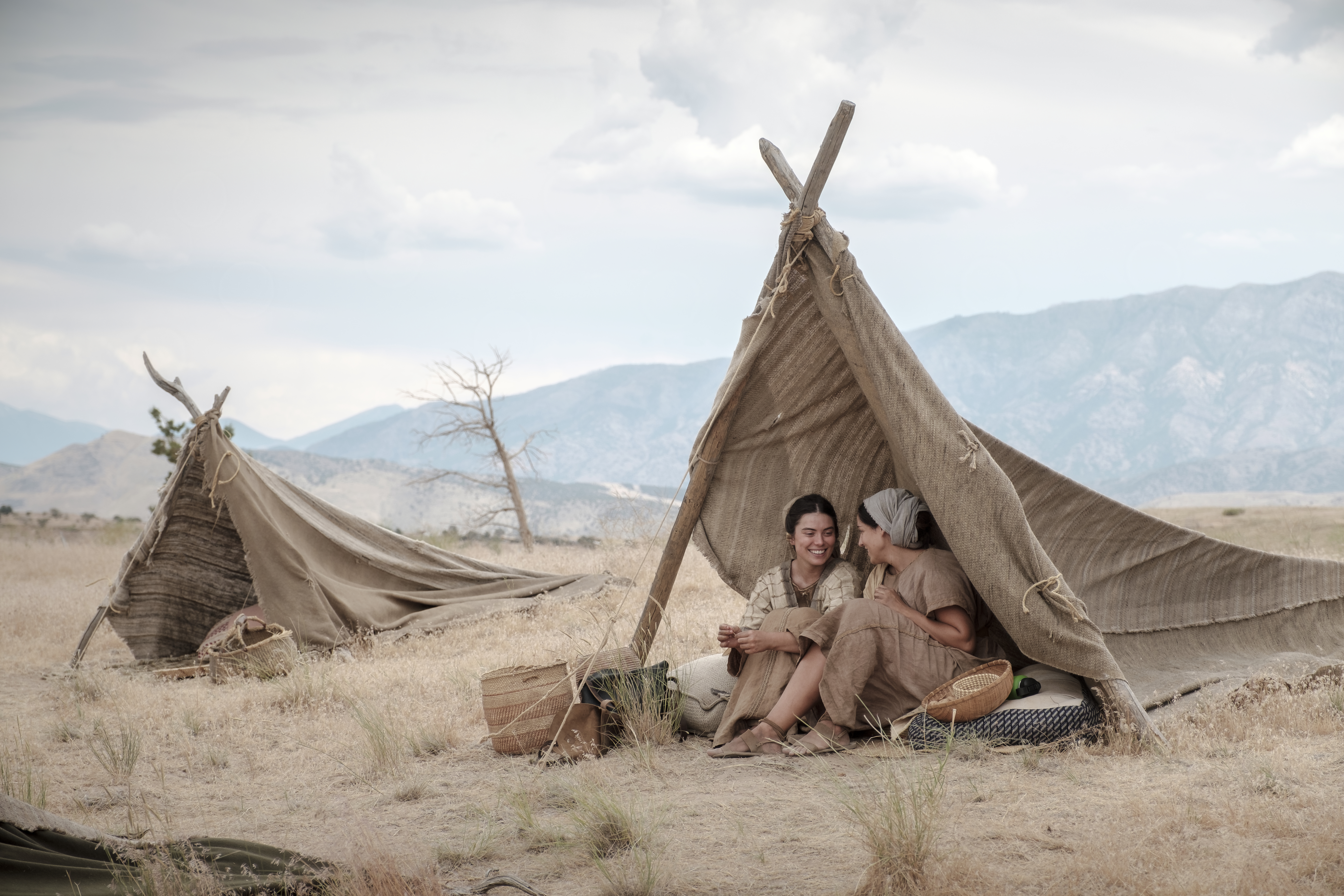 Ishmael's daughters sit beneath a tent in the wilderness.