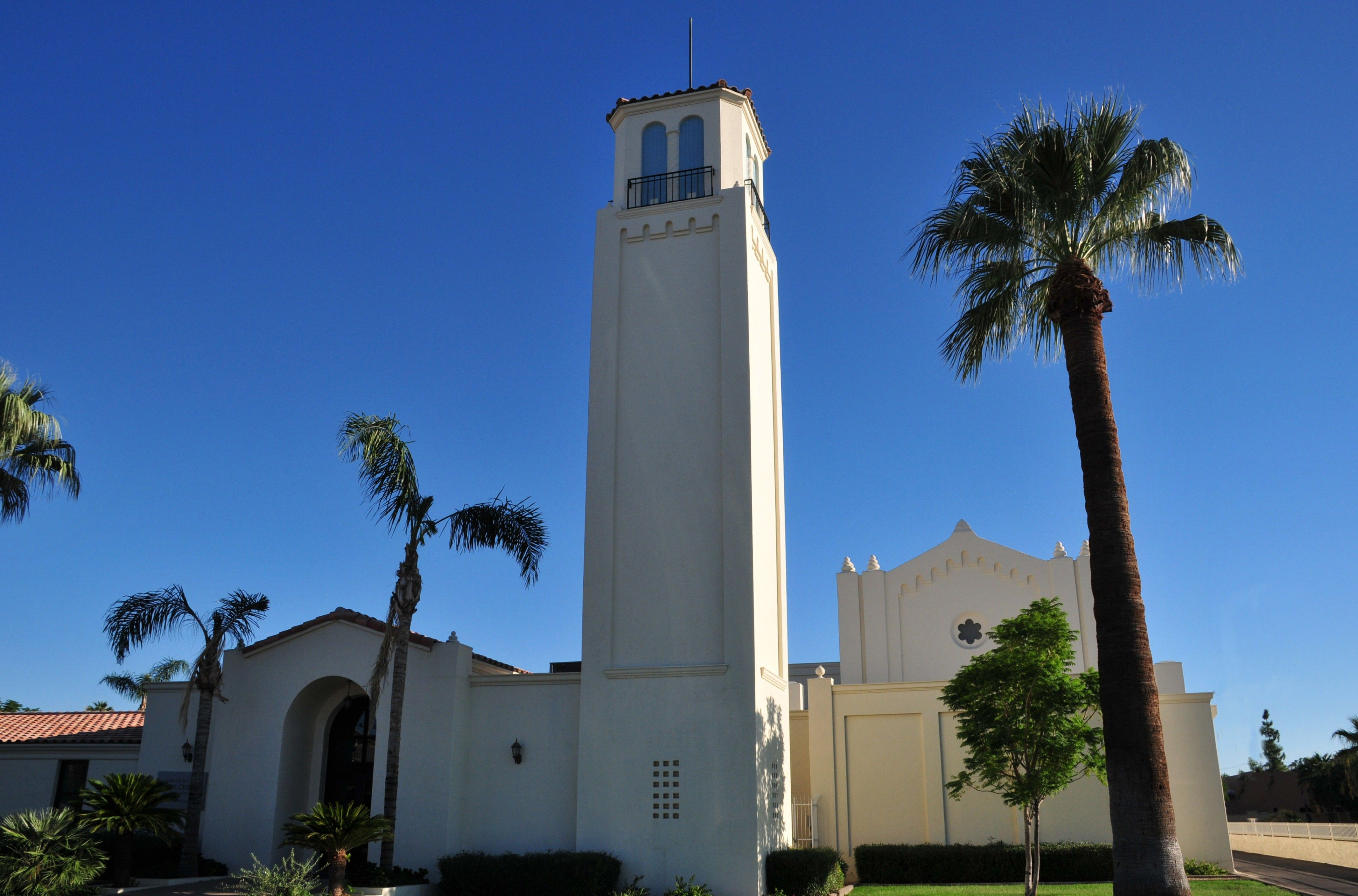 A white chapel and palm trees in Mesa, Arizona.