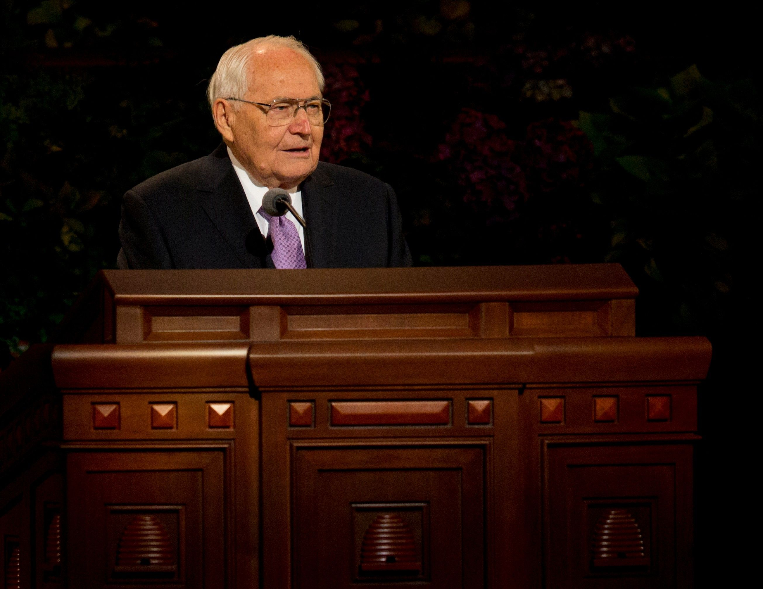 L. Tom Perry standing to speak to the congregation at general conference.