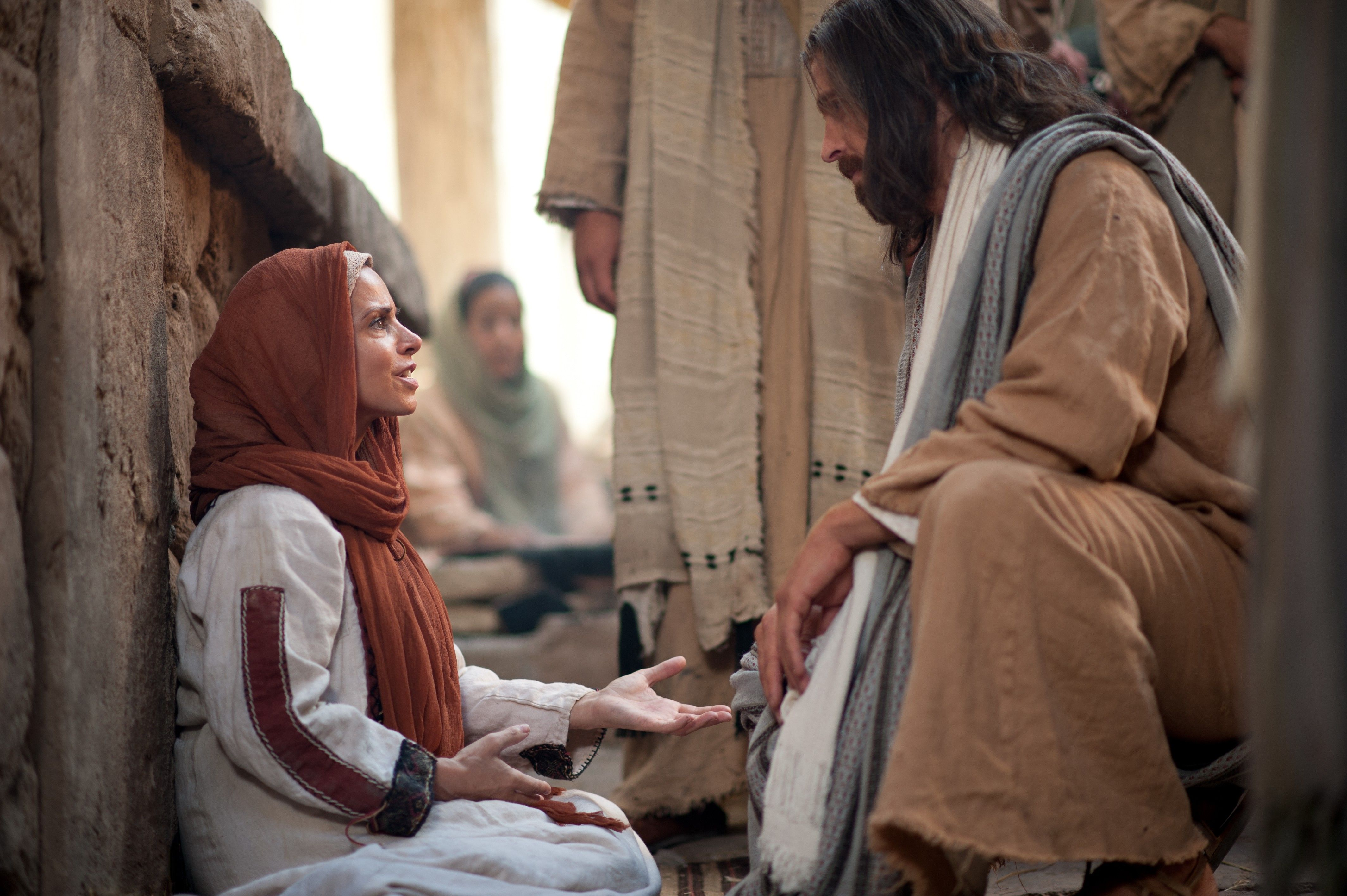 Christ conversing on the street with a woman of great faith who suffers from an issue of blood.