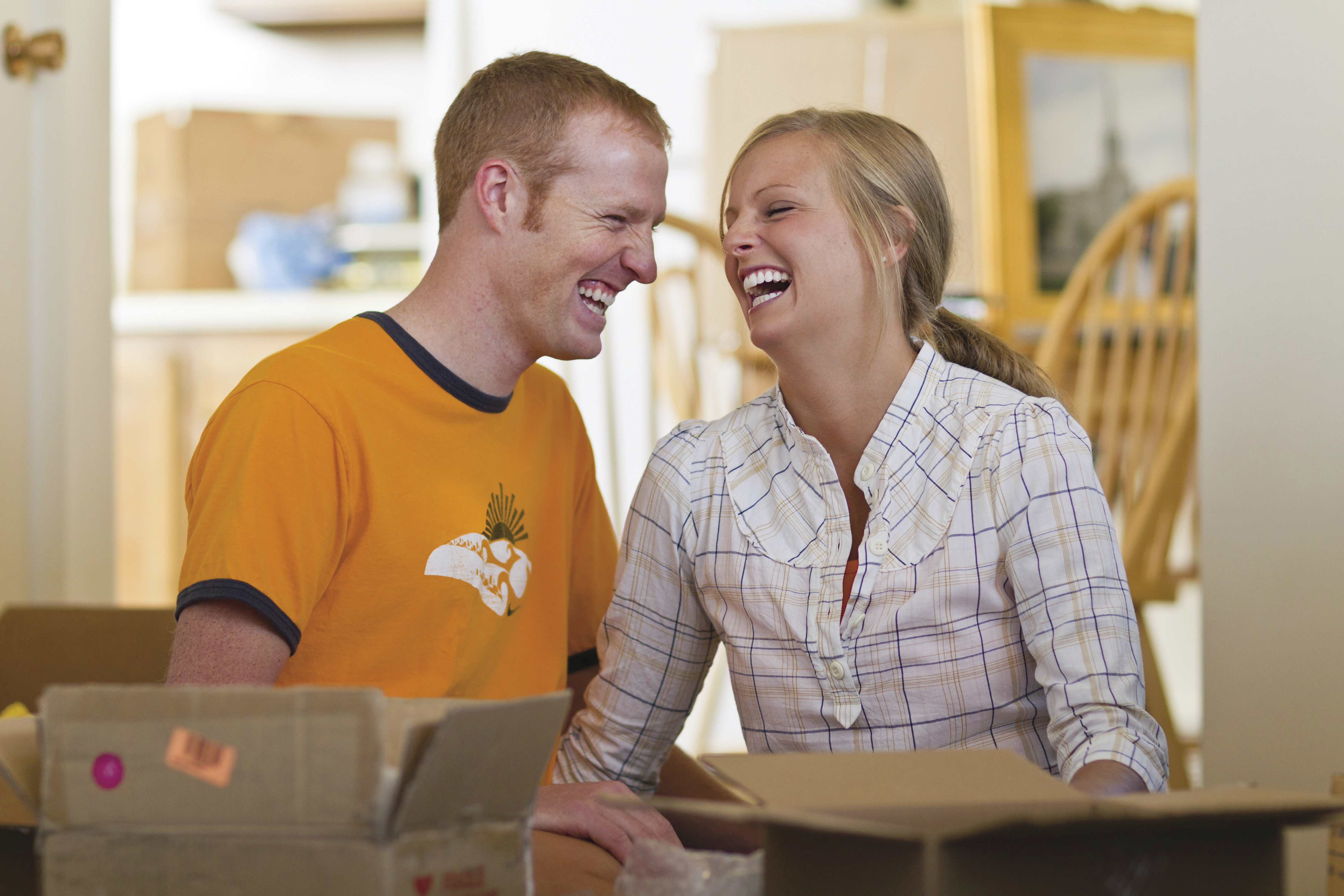 A newlywed couple moves into a new home.