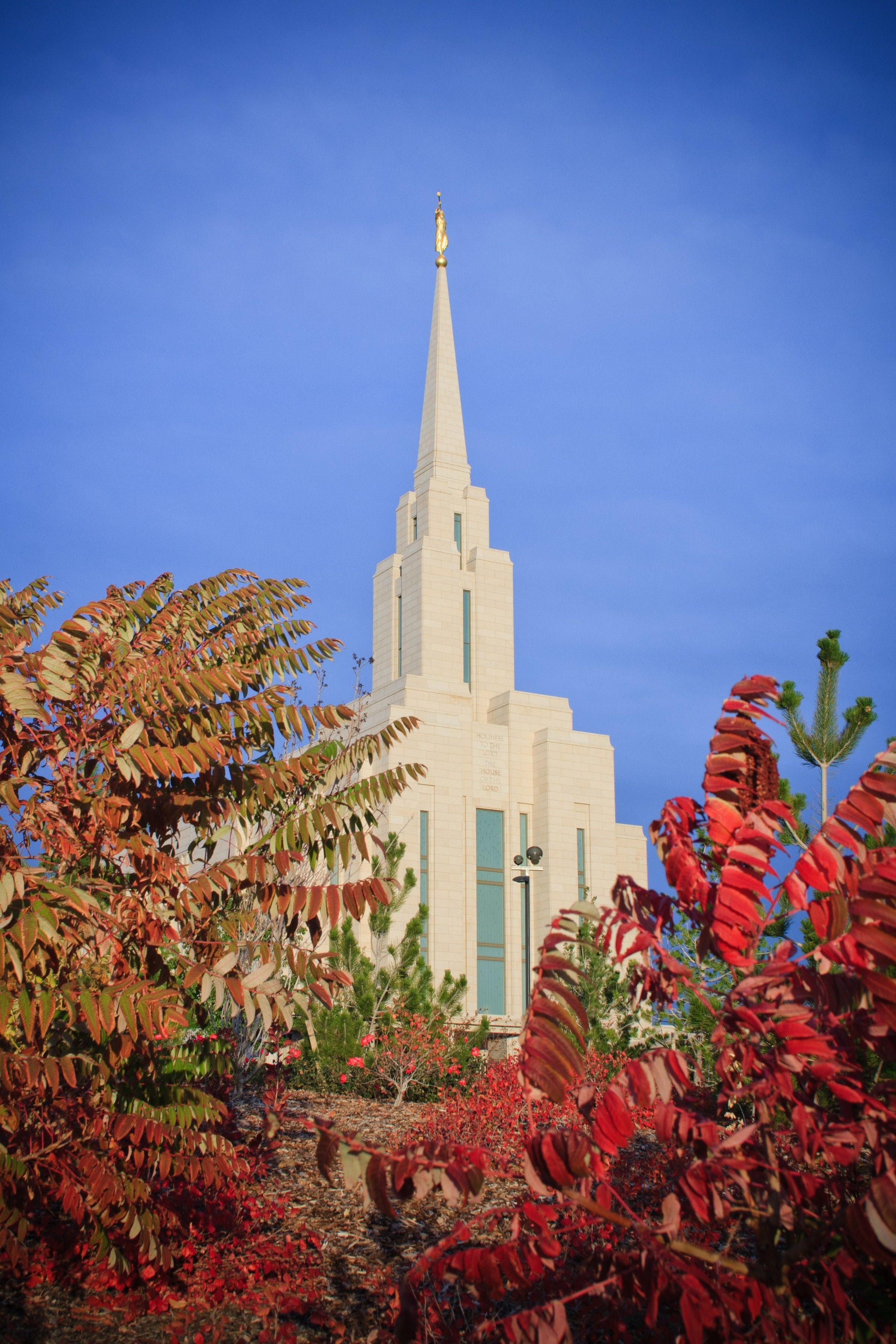 The Oquirrh Mountain Utah Temple in the fall, including the windows and spire.