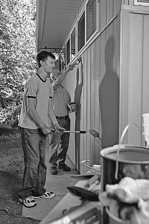 Men painting a building