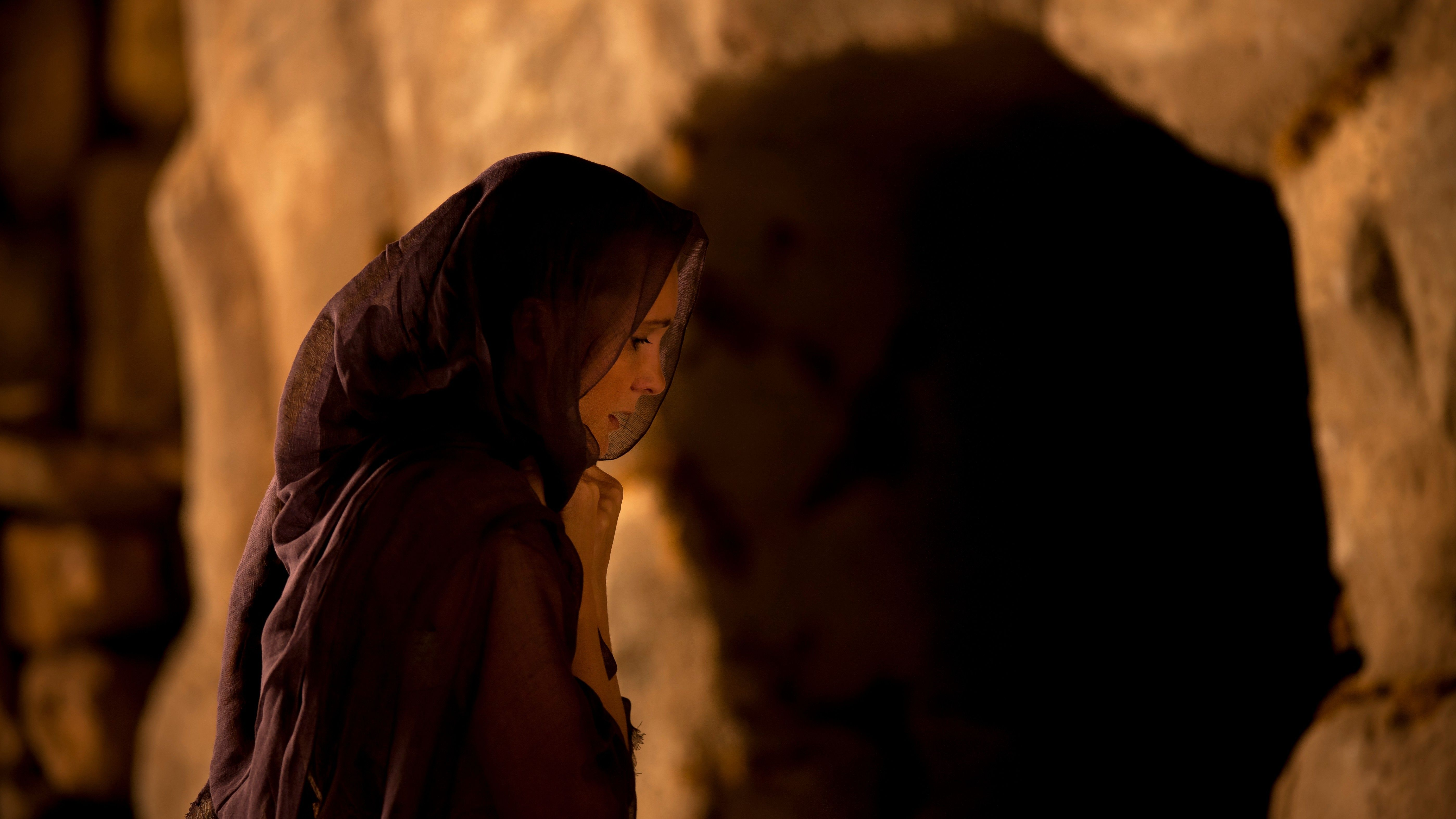 Mary Magdalene standing alone outside of an empty tomb.