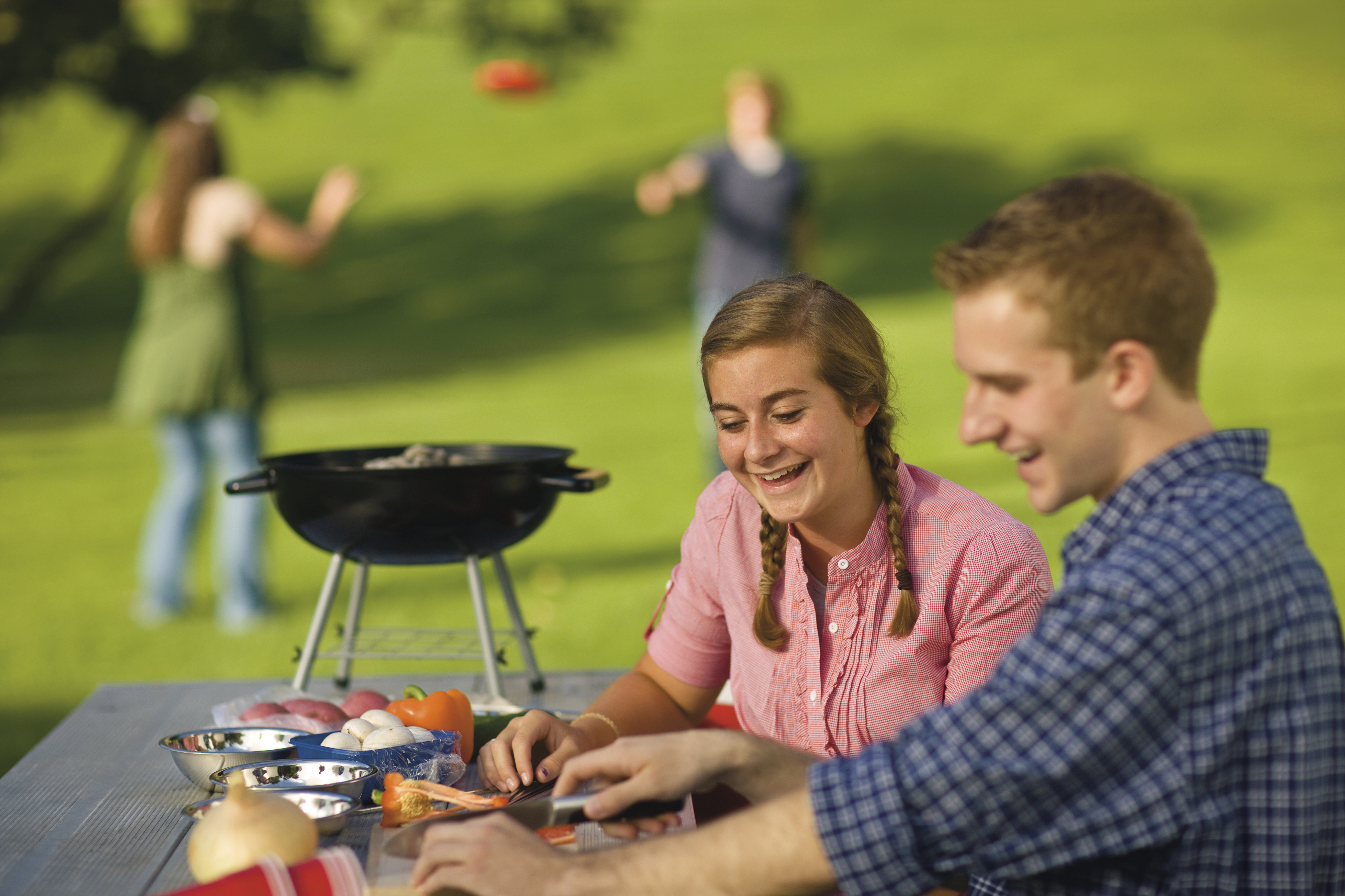 A young couple goes on a date at a barbecue.