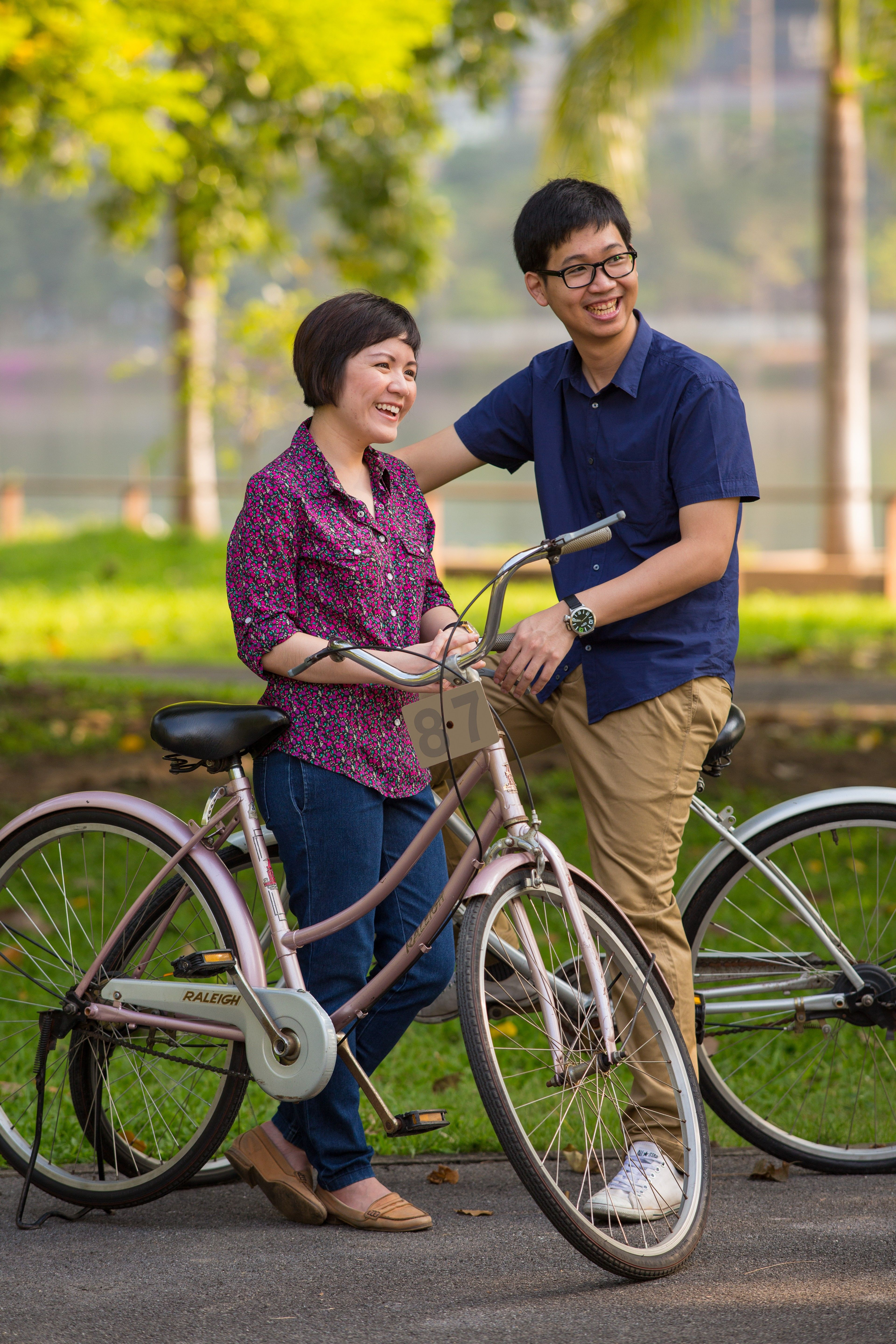 A couple outside with their bikes.