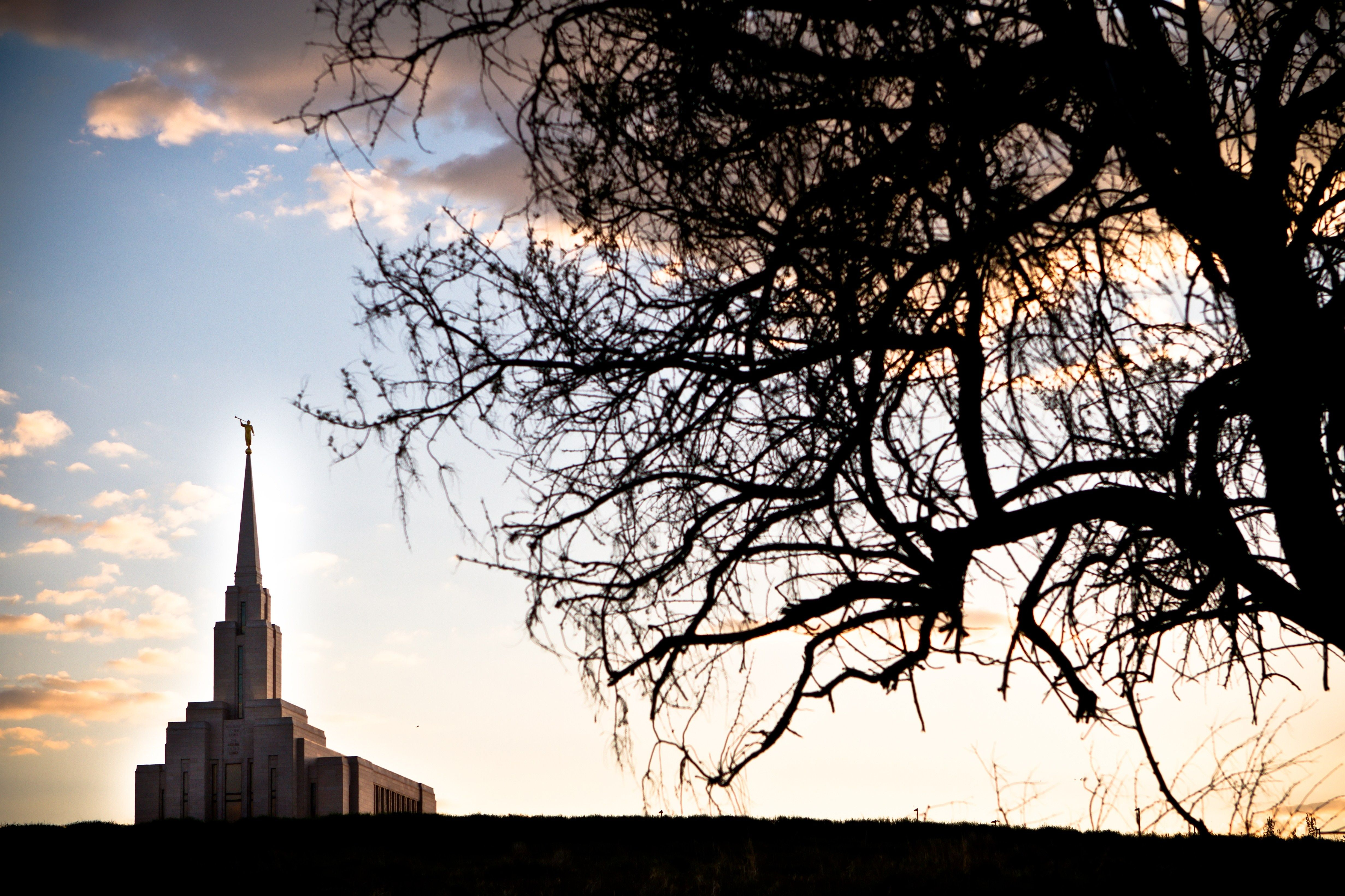 The Oquirrh Mountain Utah Temple at sunset, including scenery.