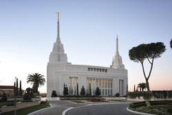 The exterior of the Rome Italy Temple during the day.