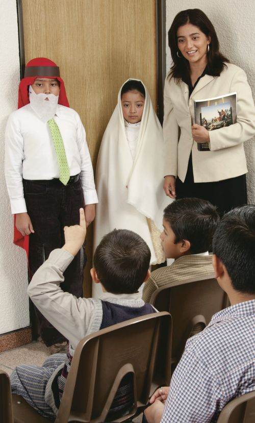Primary leader with two children dressed in Biblical costumes