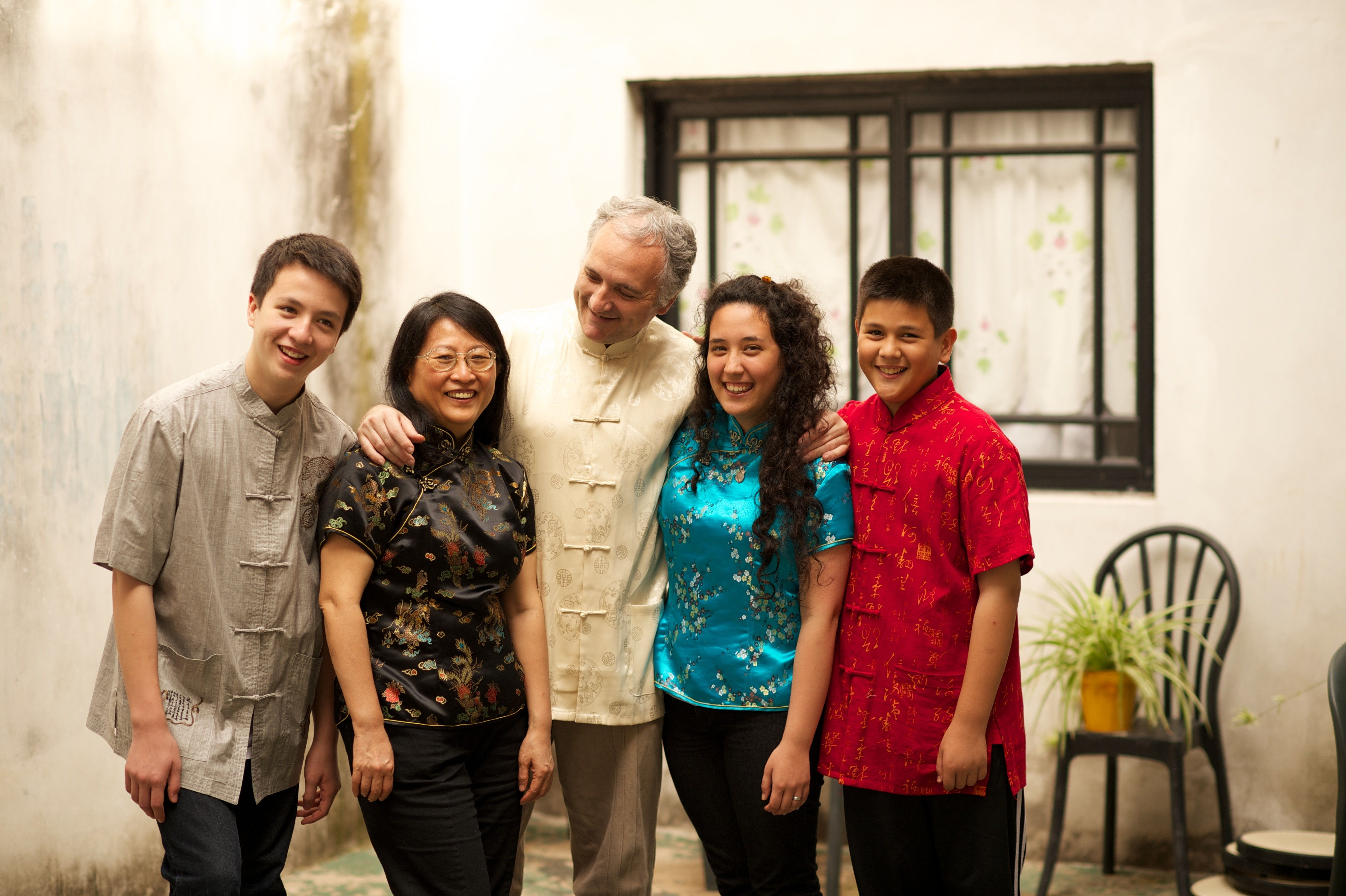 A family in traditional Chinese clothing.