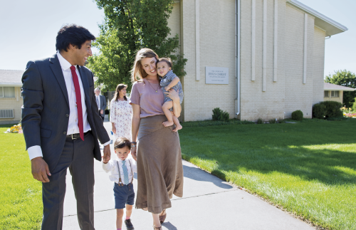 Family walking in front of LDS Meetinghouse