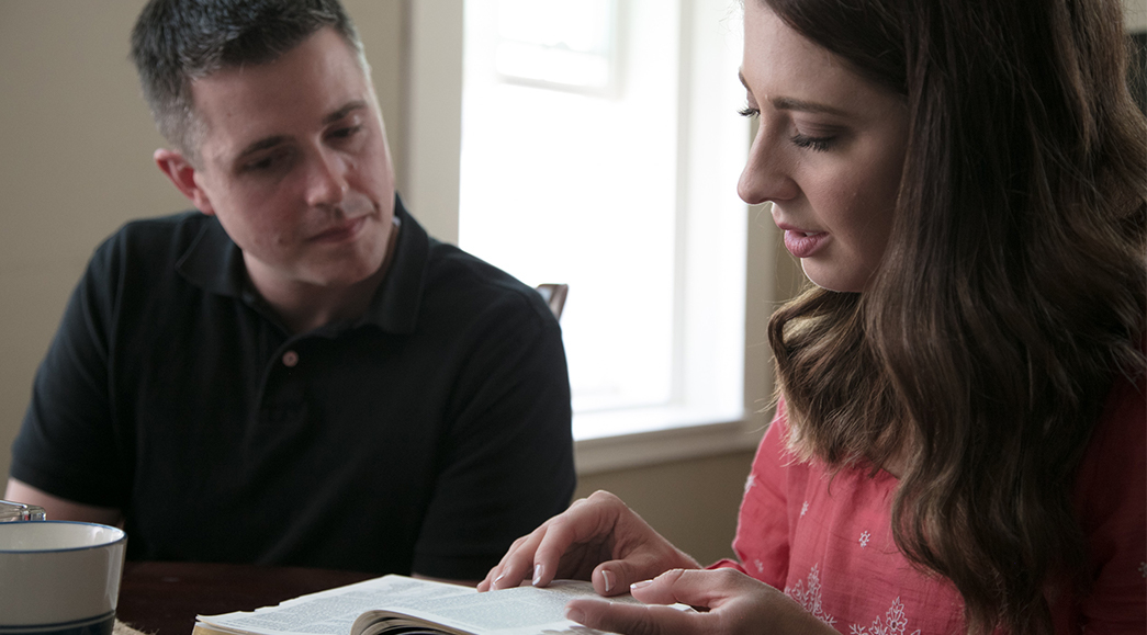 A couple sit at their kitchen table studying life lessons from the Book of Mormon