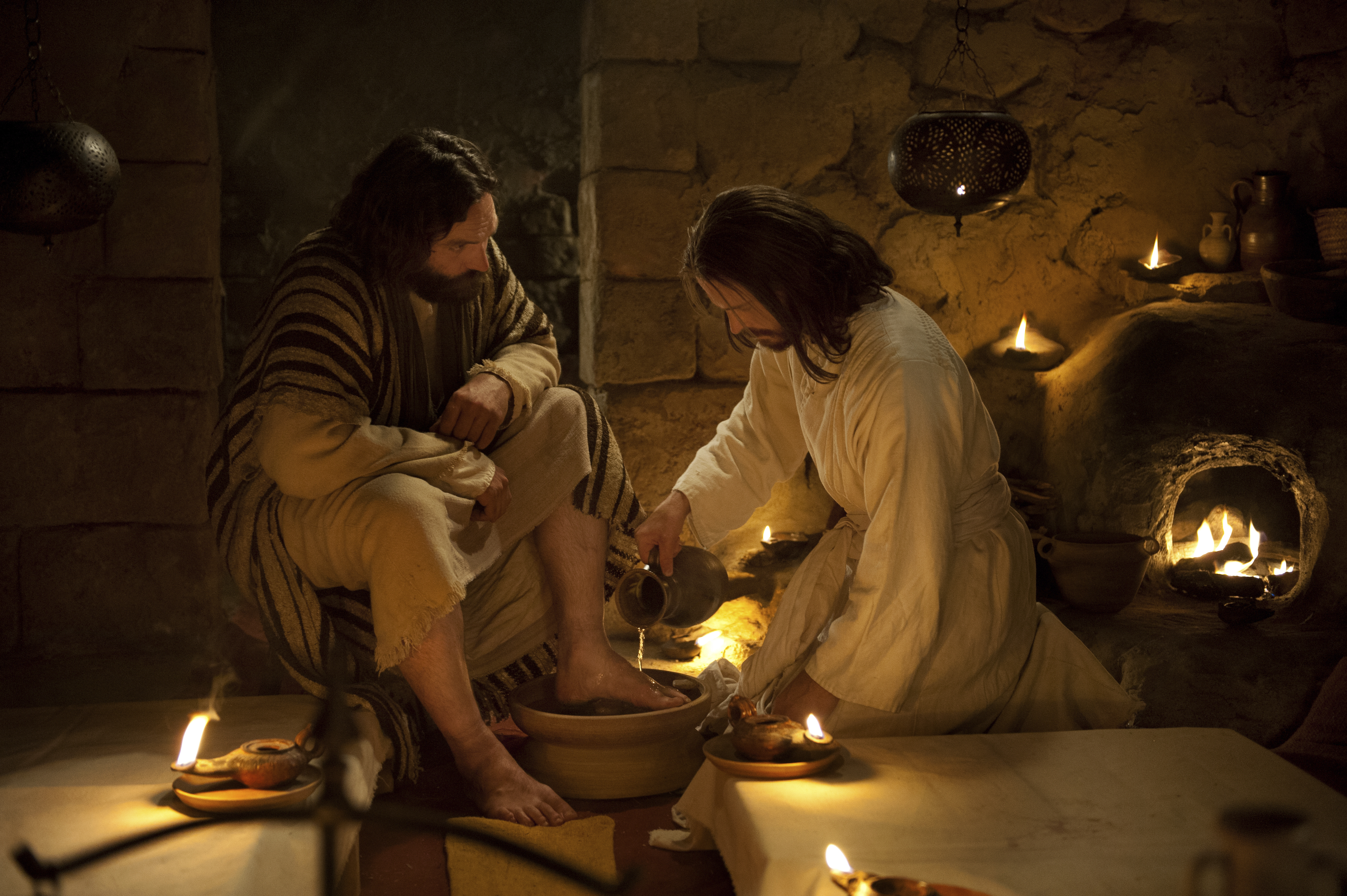 Jesus washes Peter's feet while at the Last Supper with the Apostles.