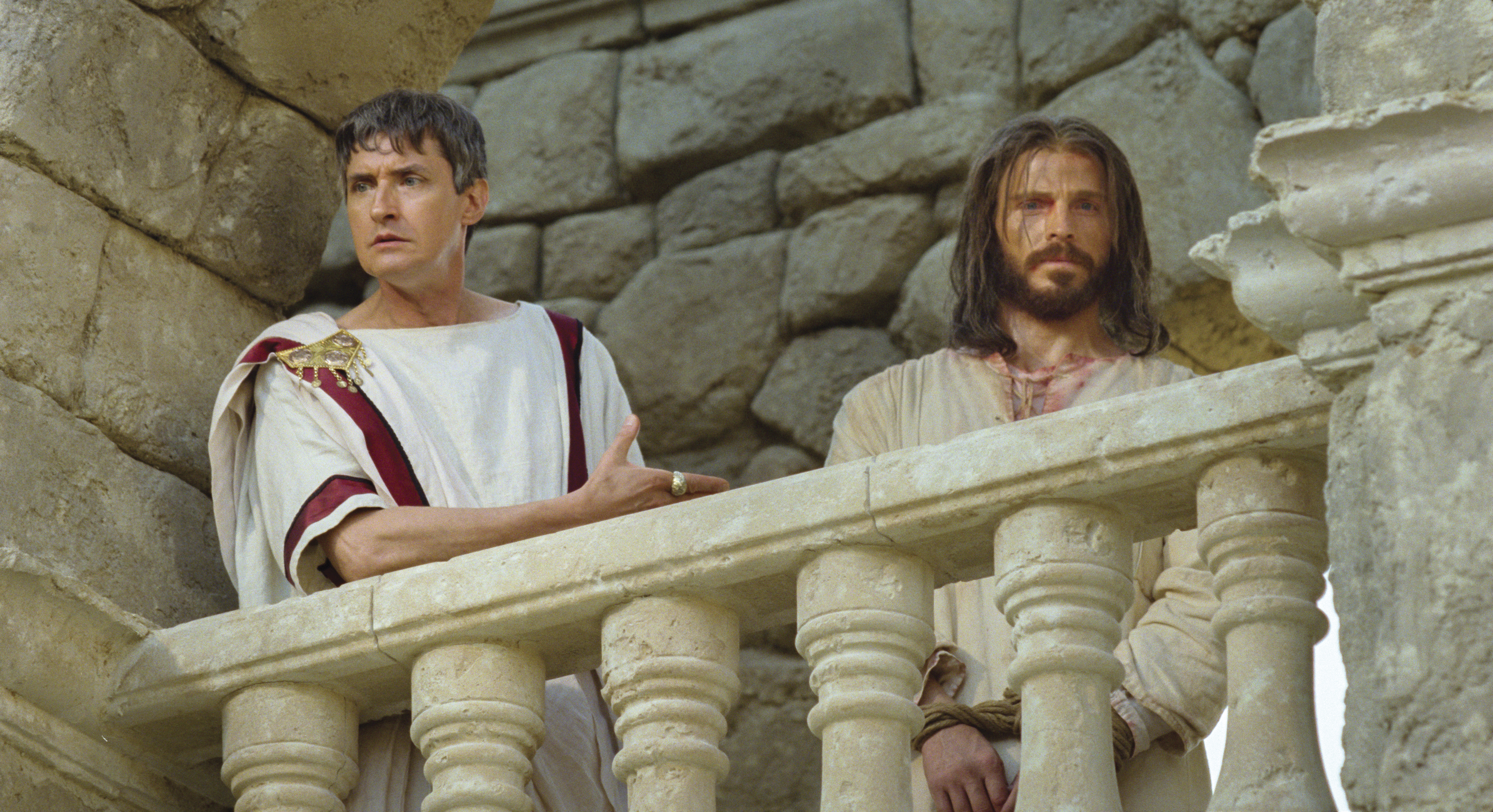 Pilate speaks to the crowd that condemns Christ.