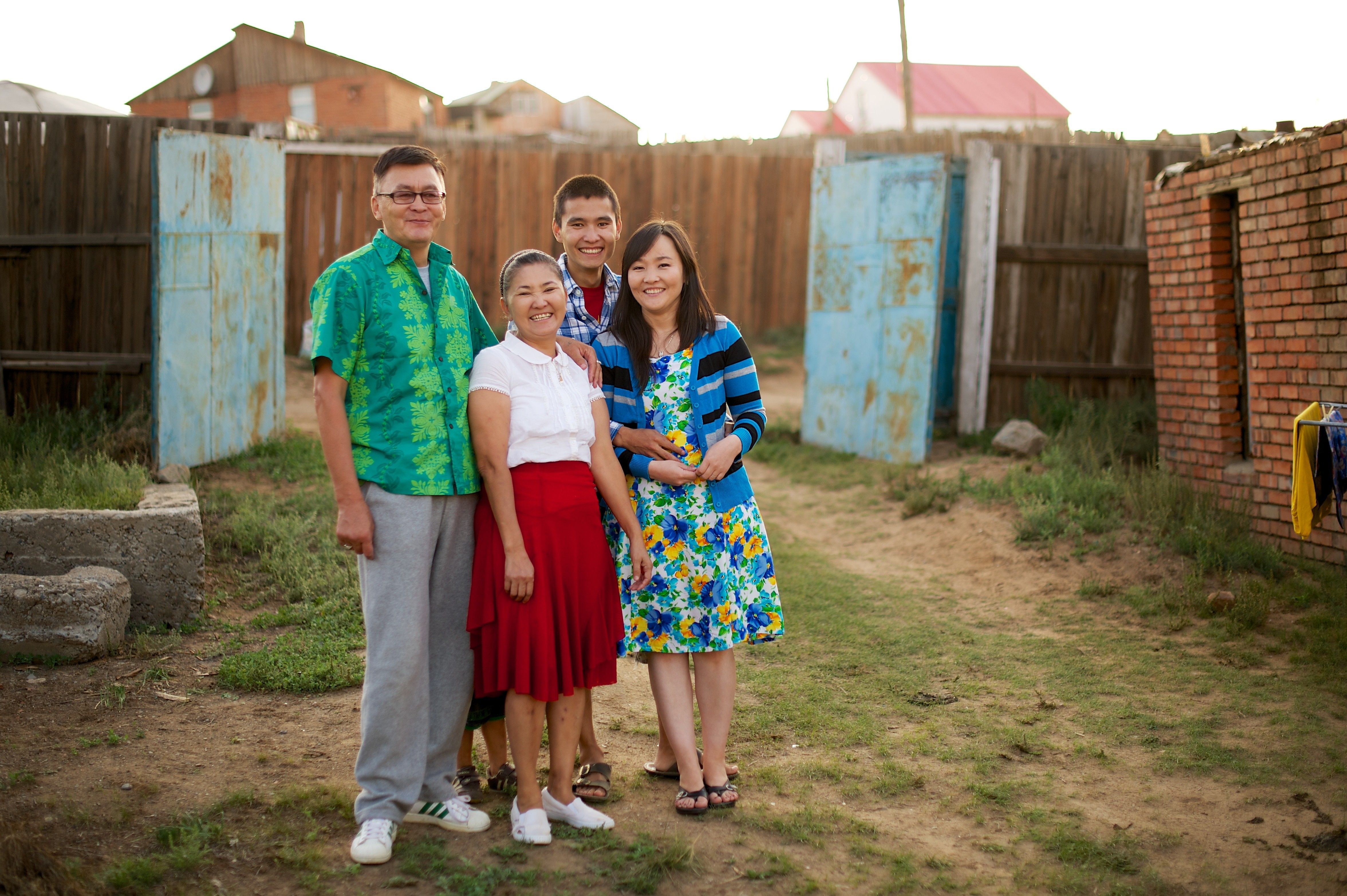 An outdoor portrait of members of a family in Mongolia.