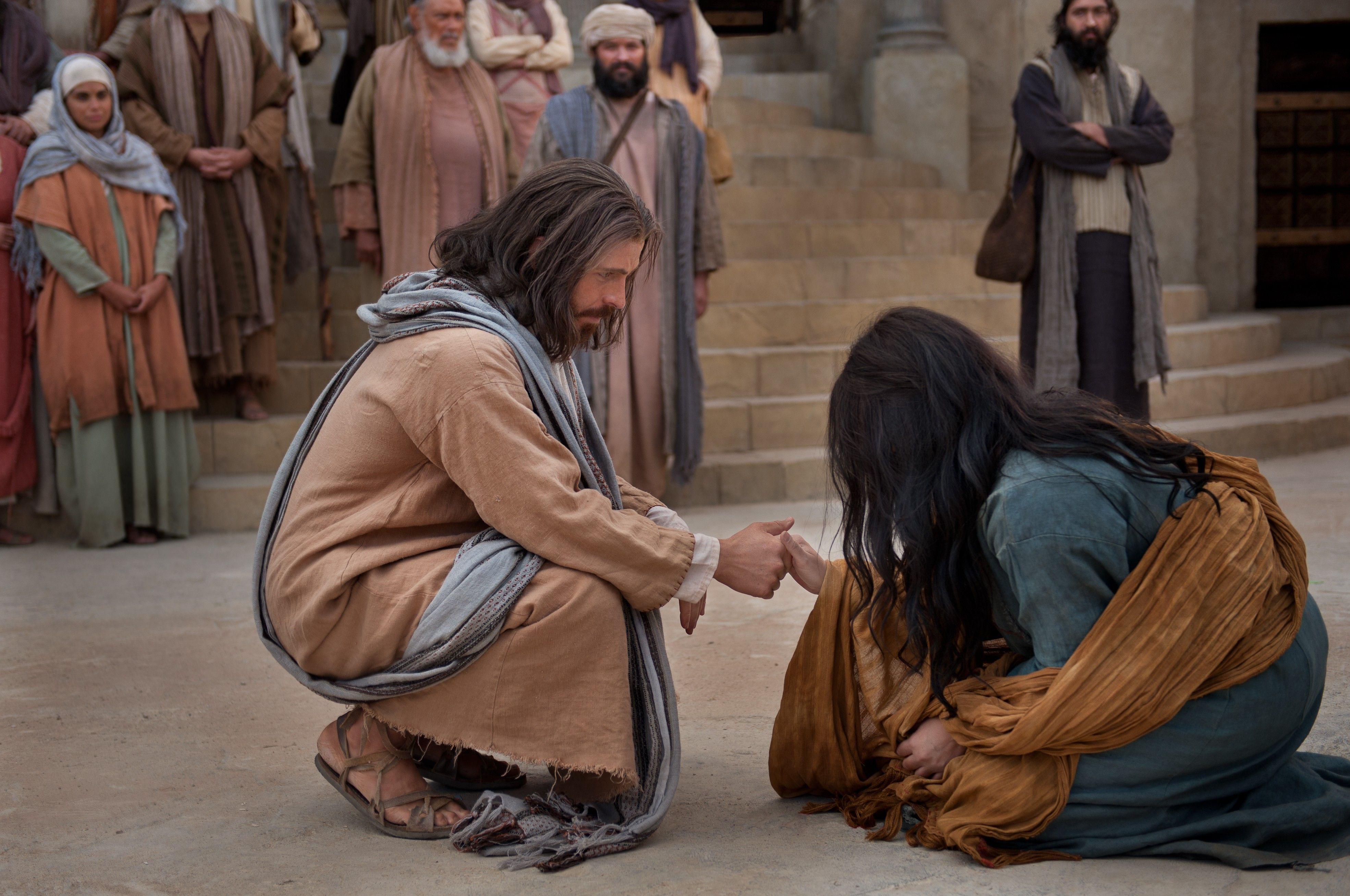 Jesus reaches out to help the woman taken in adultery.