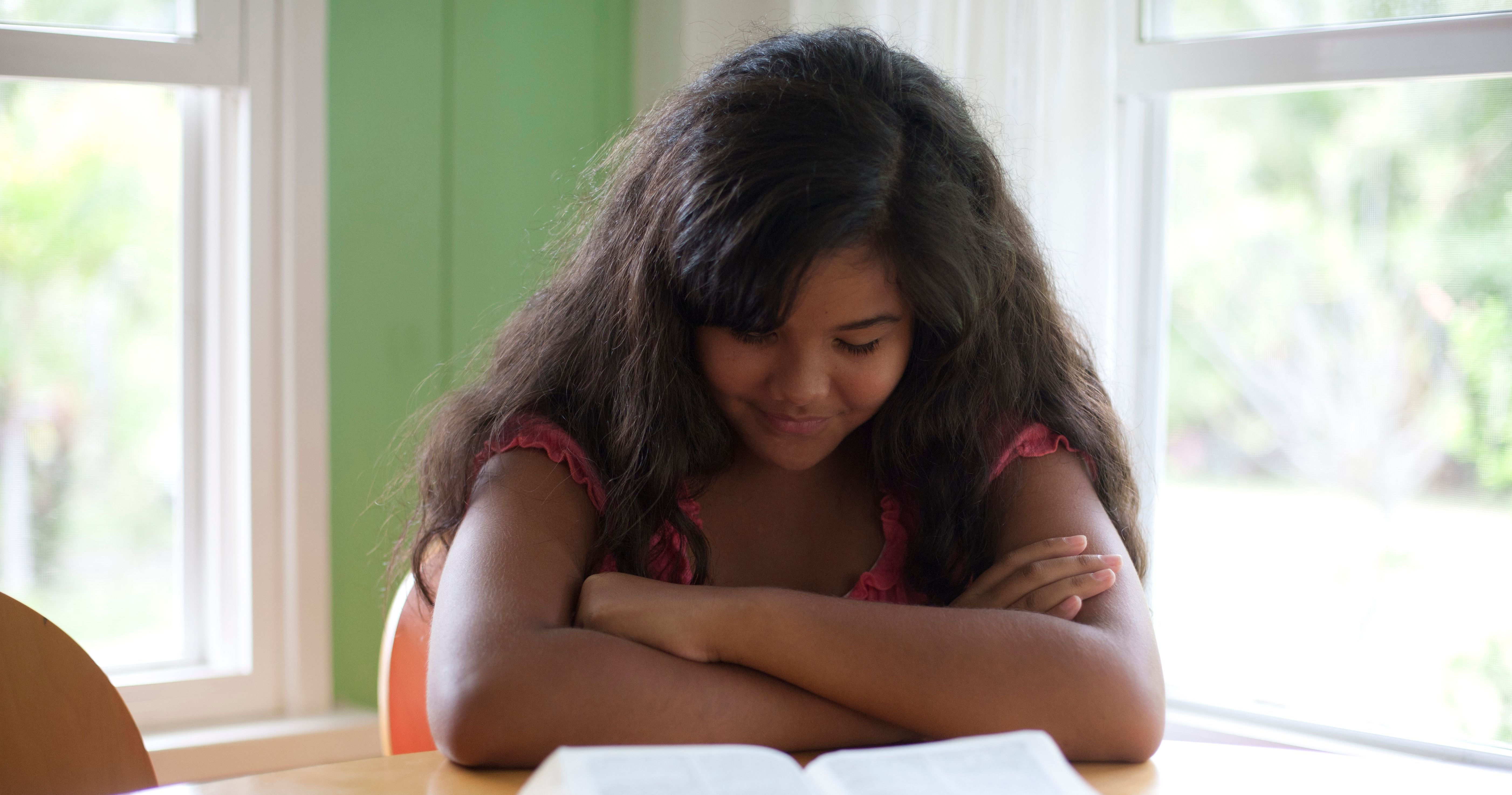 Young woman reads scriptures