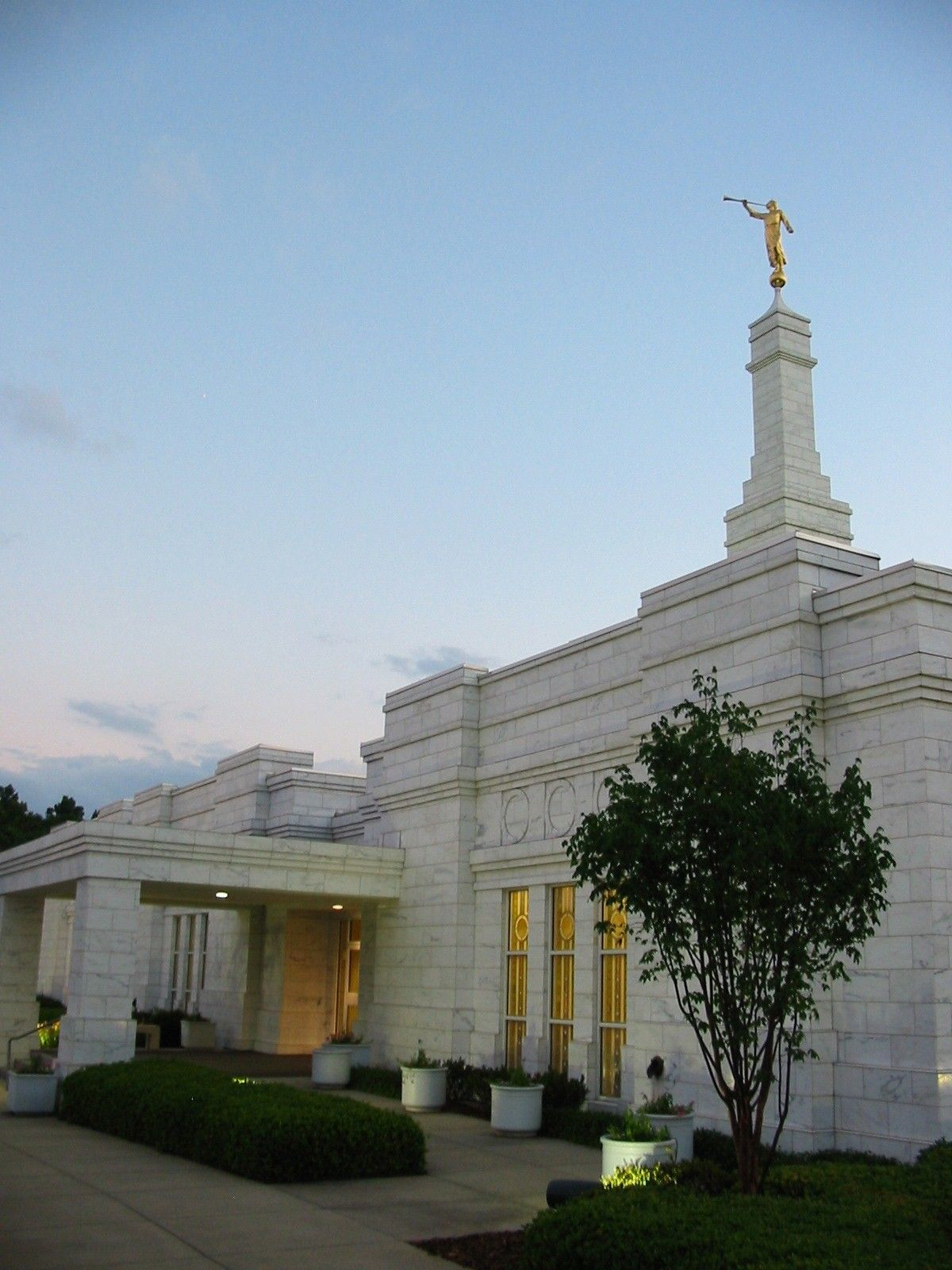 The entrance to the Birmingham Alabama Temple is lit up in the evening.