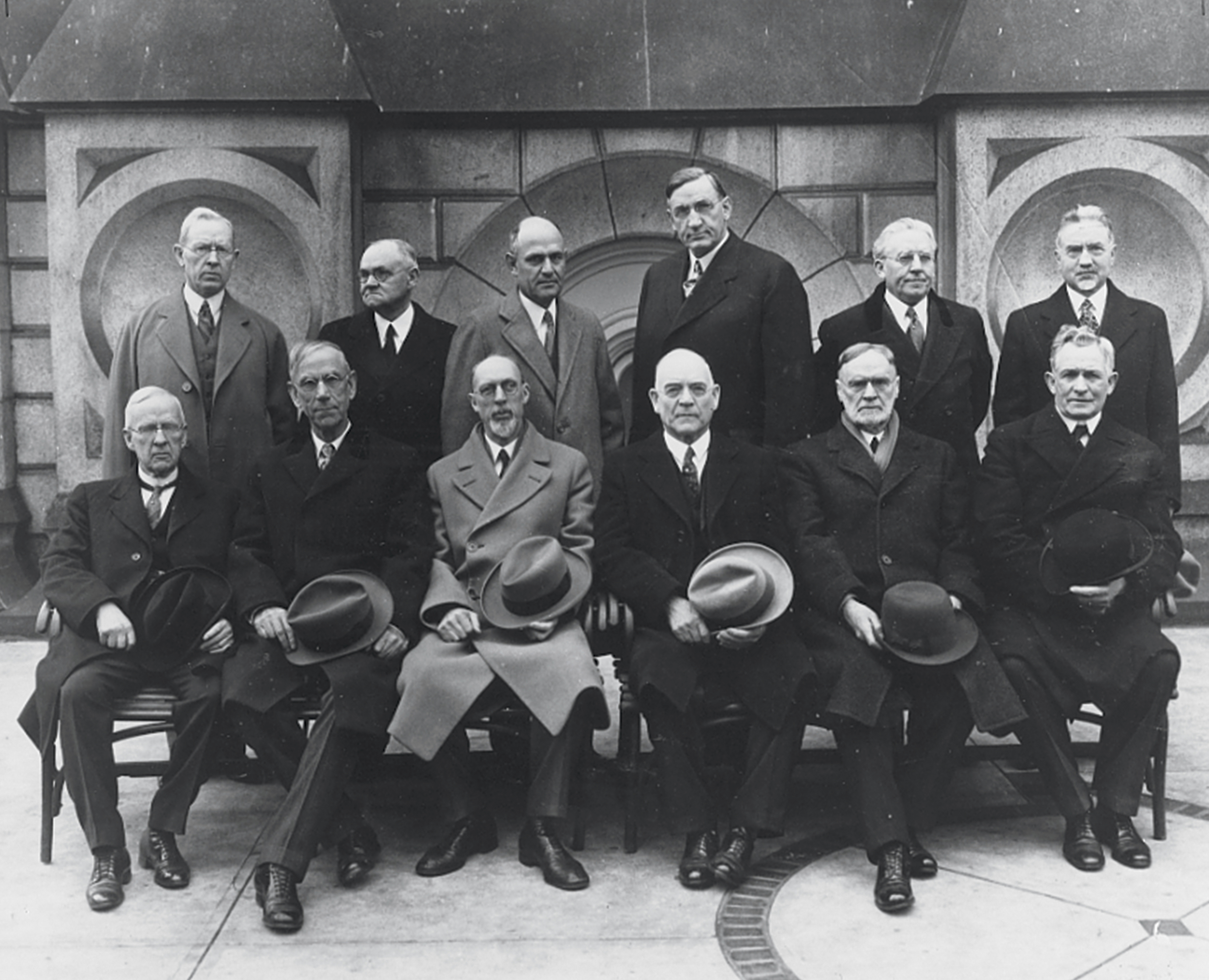 The Quorum of the Twelve Apostles in 1921. Standing, left to right: Joseph Fielding Smith, James E. Talmage, Stephen L Richards, Richard R. Lyman, Melvin J. Ballard, and John A. Widtsoe. Seated, left to right: Rudger Clawson, Reed Smoot, George Albert Smith, George F. Richards, Orson F. Whitney, and David O. McKay. Teachings of Presidents of the Church: George Albert Smith (2011), xx