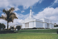 The Villahermosa Mexico Temple, including the entrance and palm trees on the grounds.